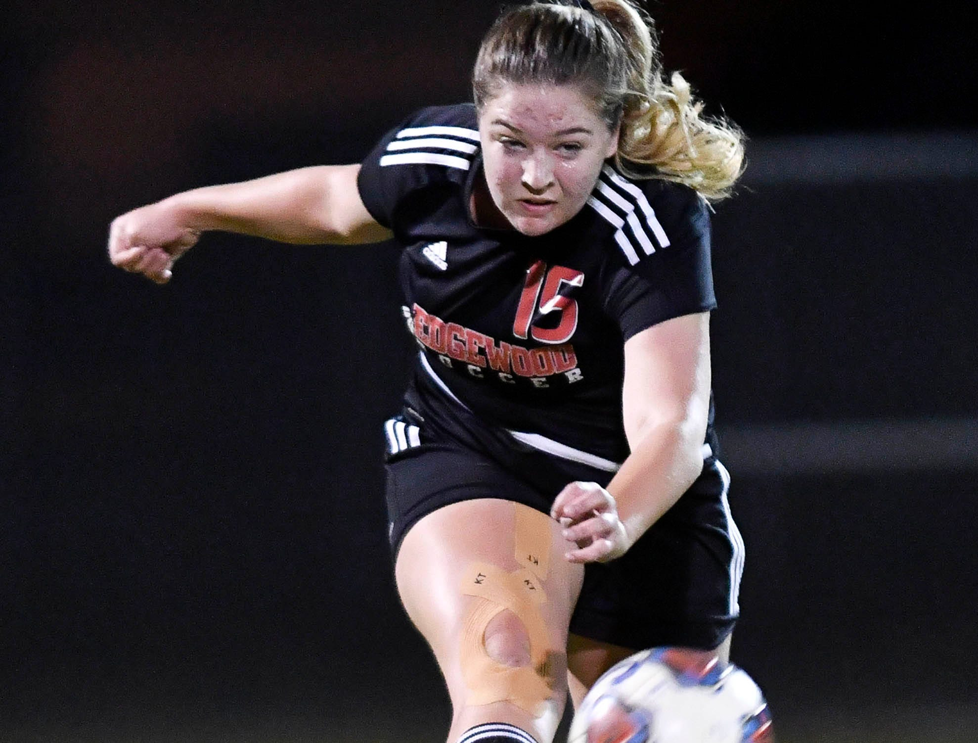 Edgewood's Julia Passarelli drives the ball downfield during Friday's Class 2A regional semifinal against Trinity Prep.