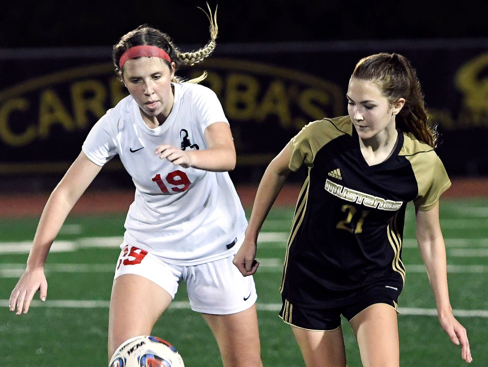 Satellite's Abigail Ferguson and Ashleigh Sweat of Merritt Island battle for control of the ball during Friday's Class 3A regional semifinal.