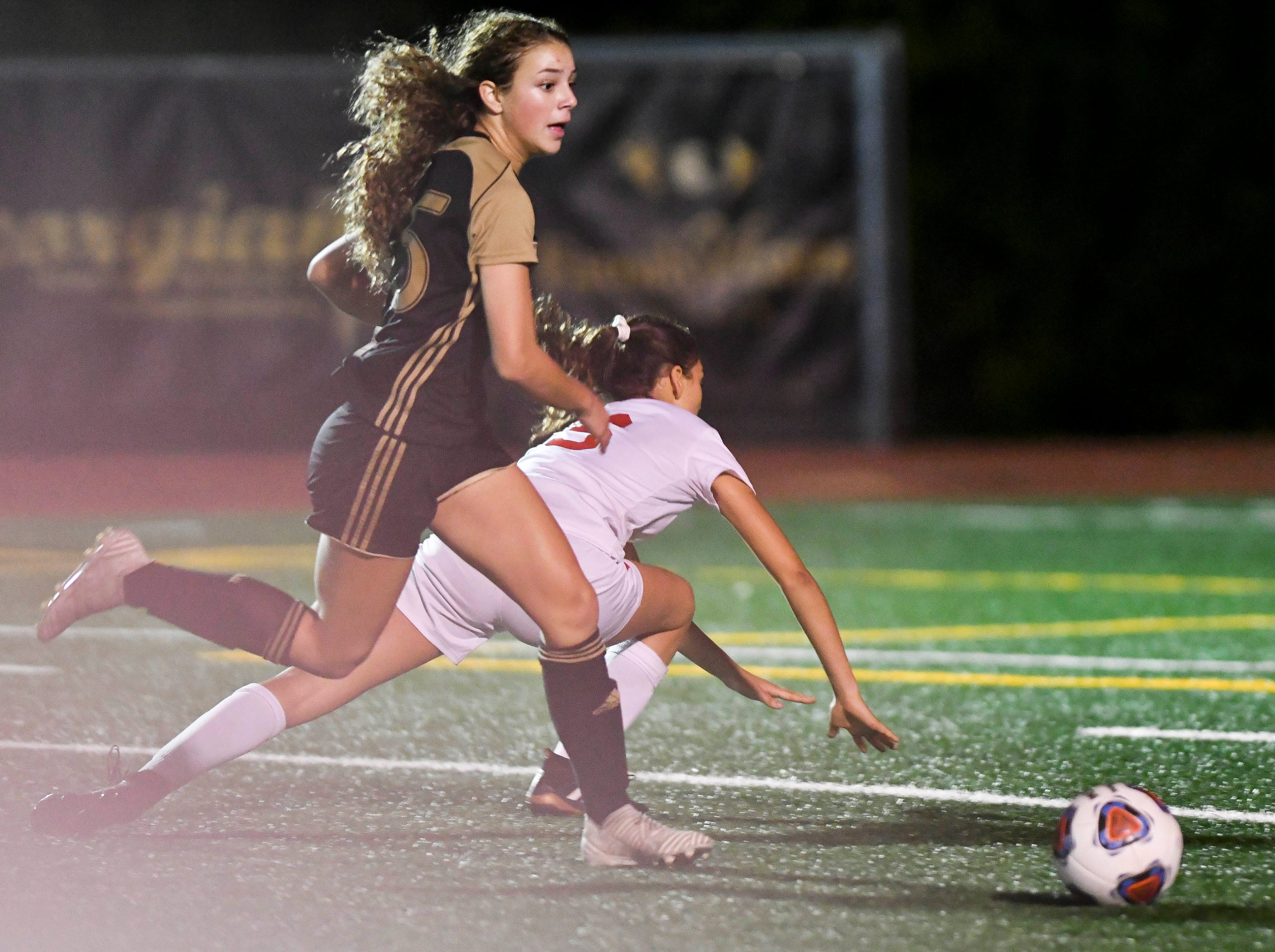 Jessica Martin of Merritt Island gets past Andria Fuentes of Satellite during Friday's Class 3A regional semifinal.