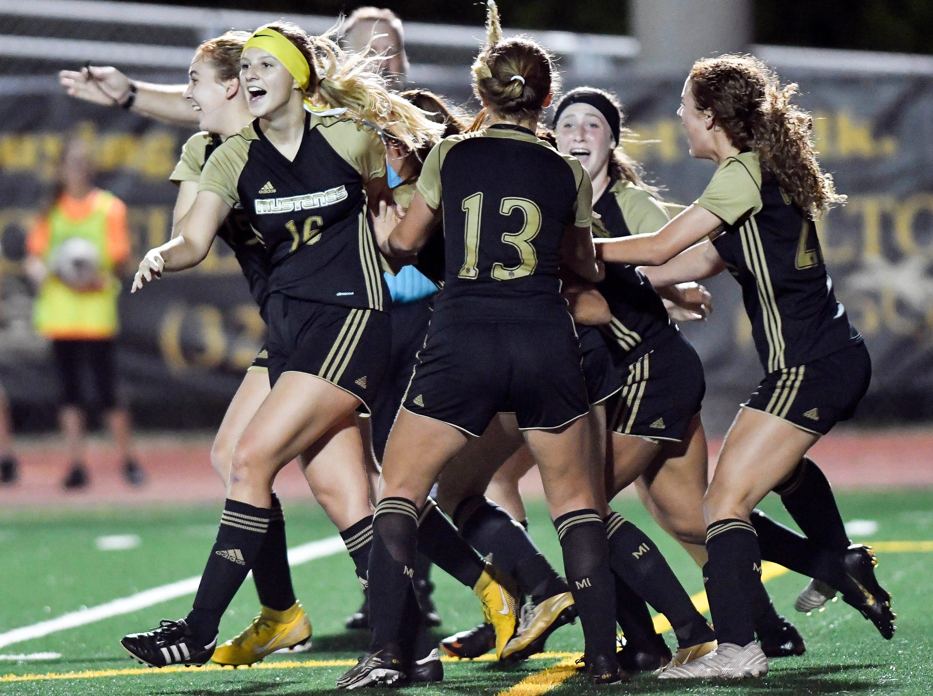 Merritt Island girls celebrate a goal during Friday's Class 3A regional semifinal against Satellite.