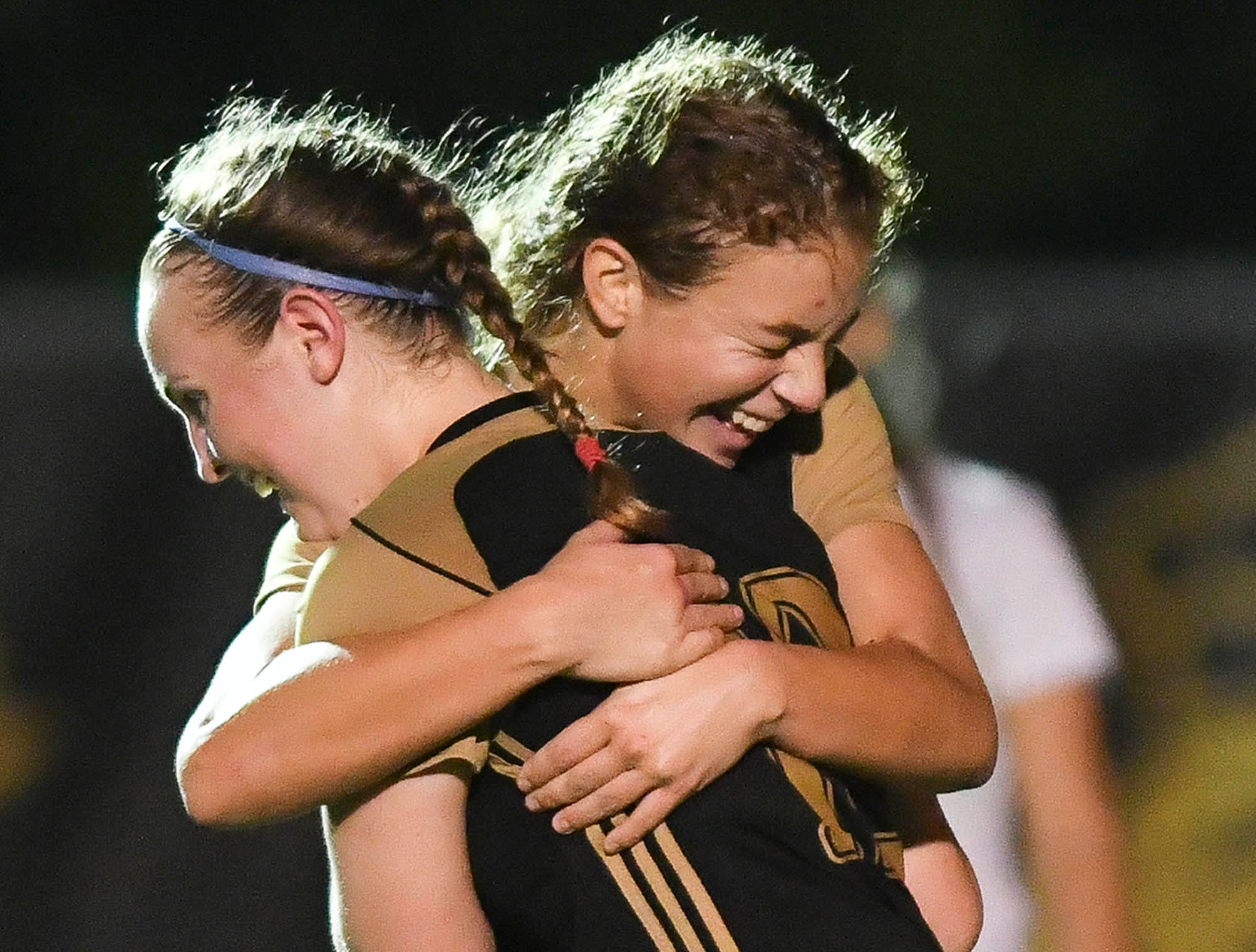 Mellissa Parker and Jessica Martin of Merritt Island celebrate a goal during Friday's Class 3A regional semifinal at Merritt Island High