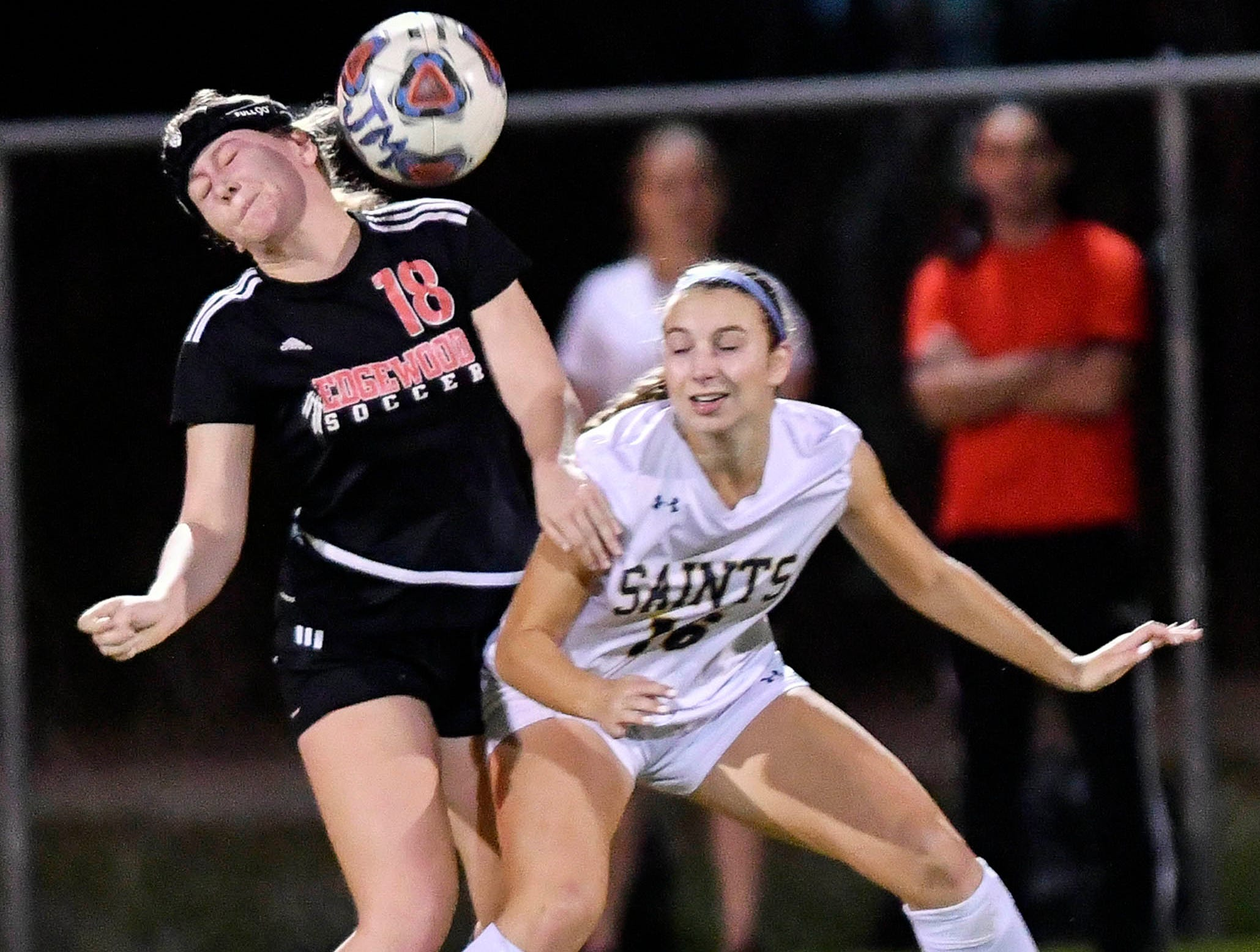 Edgewood's Shea Smithson (18) and Phoebe Fowler of Trinity Prep go for the same ball during Friday's Class 2A regional soccer semifinal.