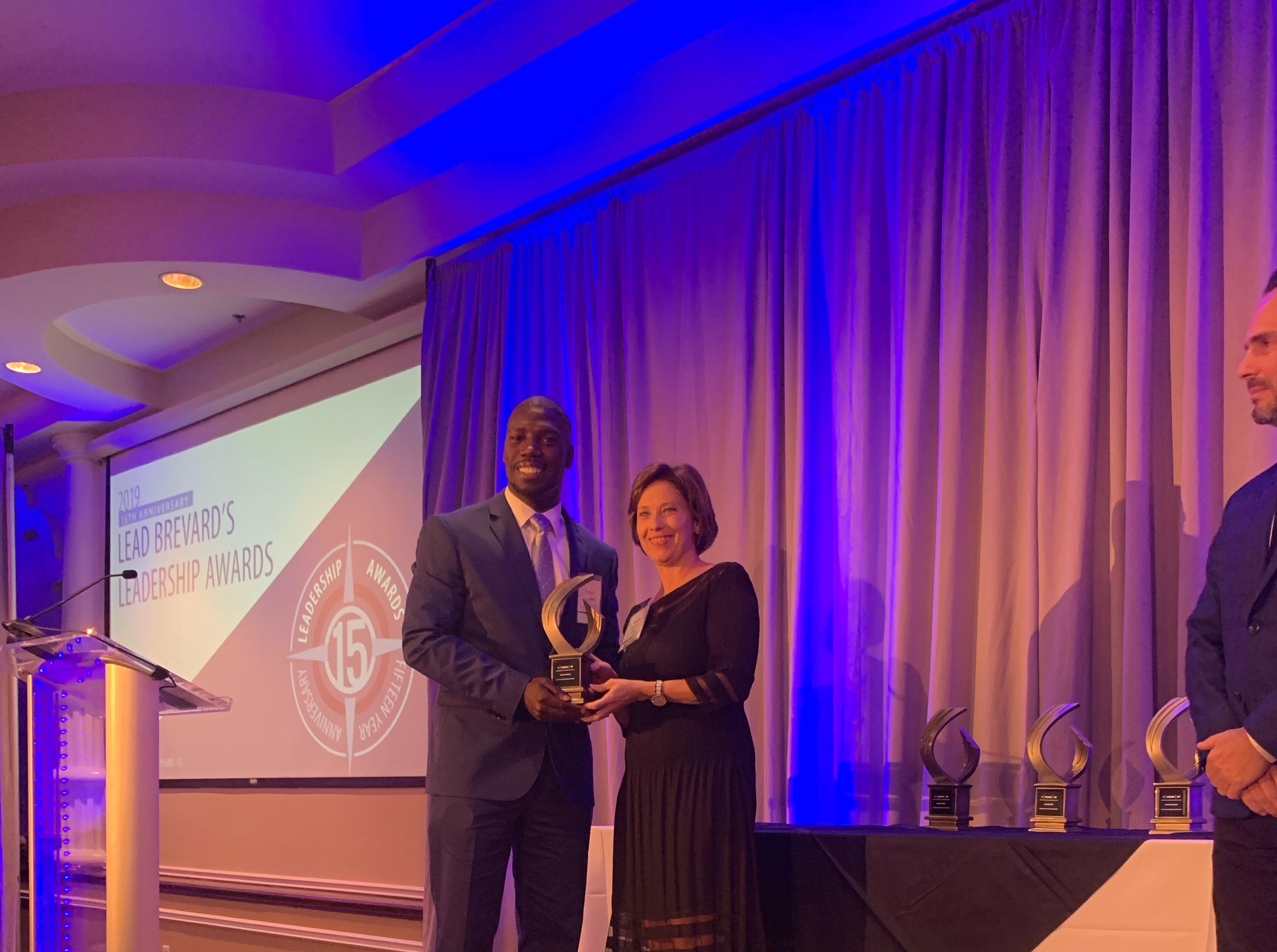 4 Under 40 recipient Trevor Howard, Director of the Dorcas Center for Kids, Neighbor Up Brevard  Sponsored by Health First.  Presented by Paula Just, Chief Human Resources Officer, Health First
