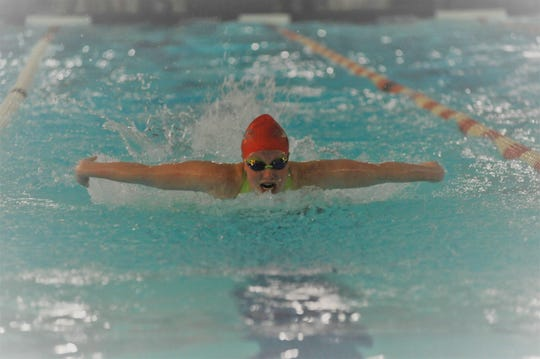 Shelby's Rylie White shows her winning form in the 100 butterfly during Saturday's Division II sectional meet.