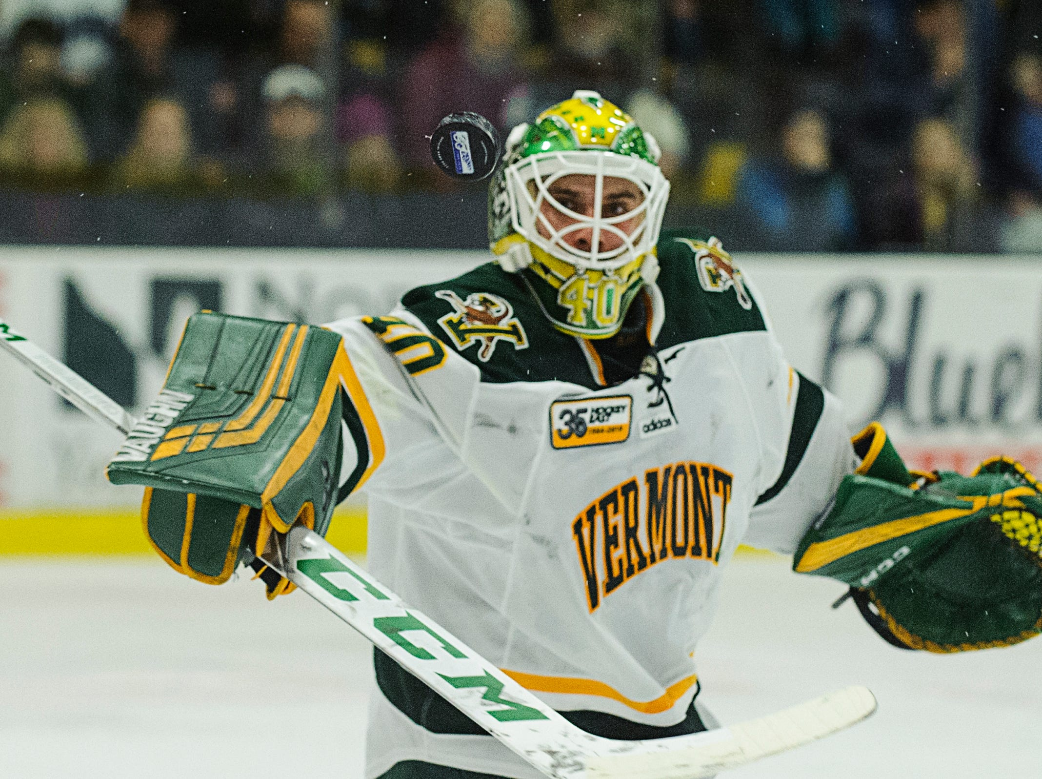 Vermont goalie Stefanos Lekkas (40) makes a save during the men's hockey game between the New Hampshire Wildcats and the Vermont Catamounts at Gutterson Field House on Friday night February 8, 2019 in Burlington, Vermont.