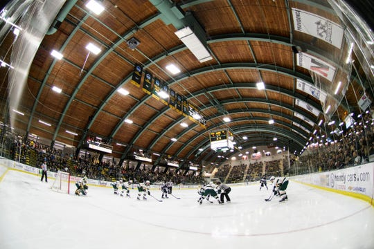 Vermont and New Hampshire faec off during the men's hockey game between the New Hampshire Wildcats and the Vermont Catamounts at Gutterson Field House on Friday night February 8, 2019 in Burlington, Vermont.