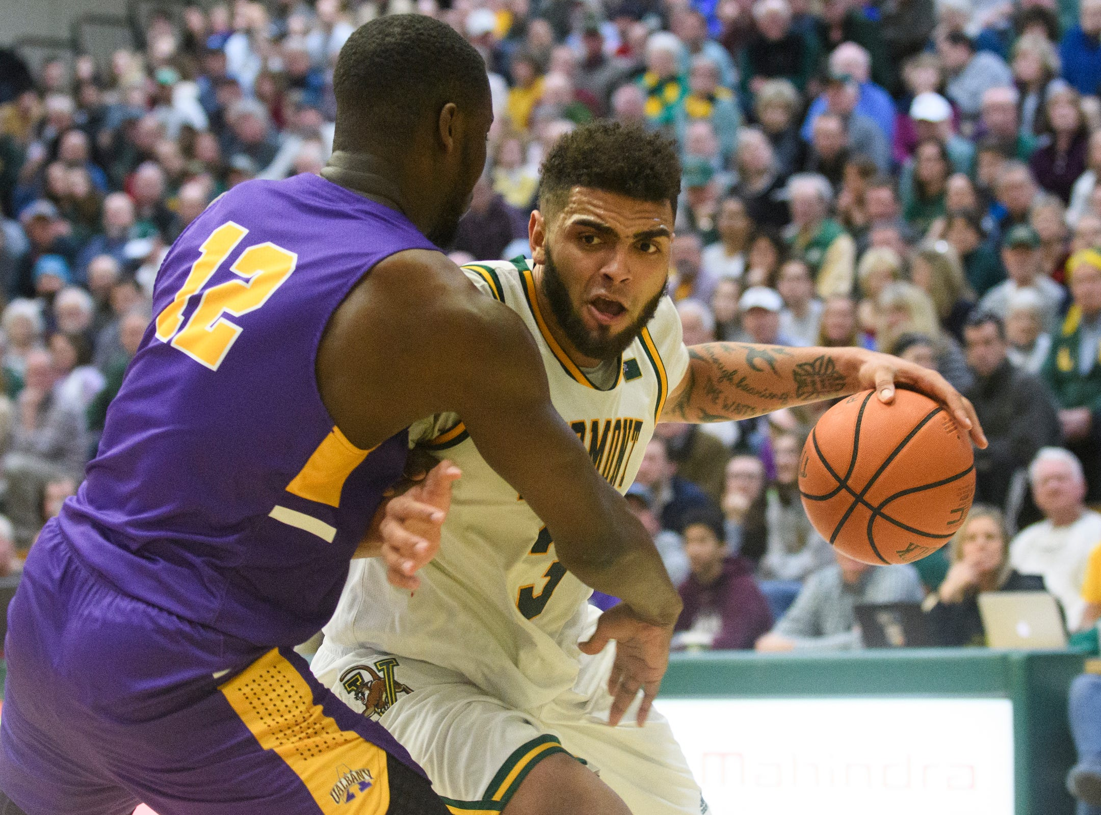 Vermont forward Anthony Lamb (3) drives to the hoop past Albany's Devonte Campbell (12) during the men's basketball game between the Albany Great Danes and the Vermont Catamounts at Patrick Gym on Saturday February 9, 2019 in Burlington, Vermont.
