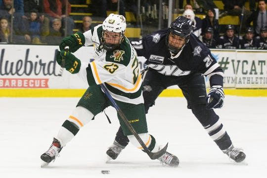 Vermont forward Max Kaufman's (23) stick breaks as he is slashed by New Hampshire's Anthony Wyse (21) during the men's hockey game between the New Hampshire Wildcats and the Vermont Catamounts at Gutterson Field House on Friday night February 8, 2019 in Burlington, Vermont.