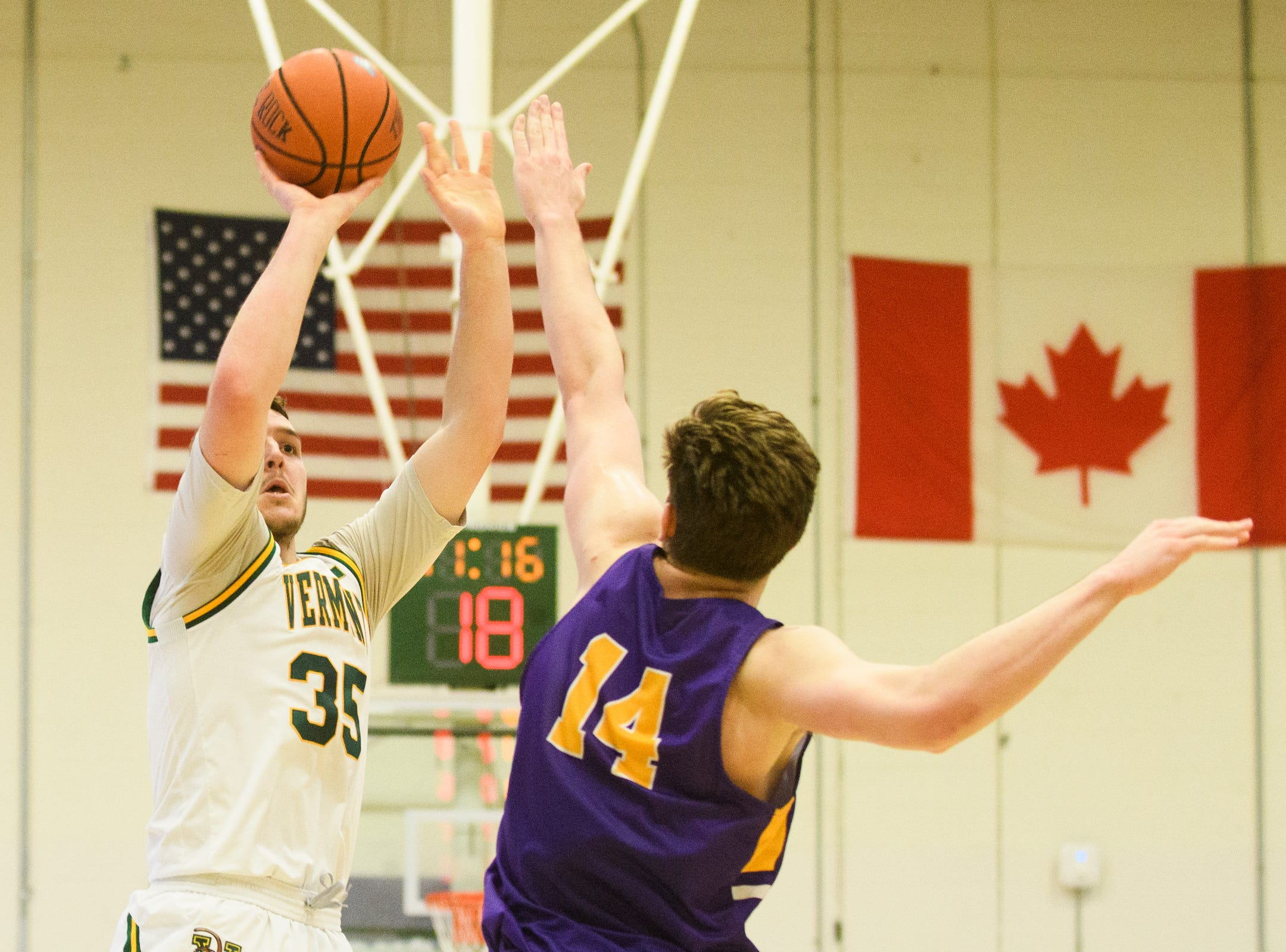 Vermont forward Ryan Davis (35) shoots the ball over Albany's Adam Lulka (14) during the men's basketball game between the Albany Great Danes and the Vermont Catamounts at Patrick Gym on Saturday February 9, 2019 in Burlington, Vermont.