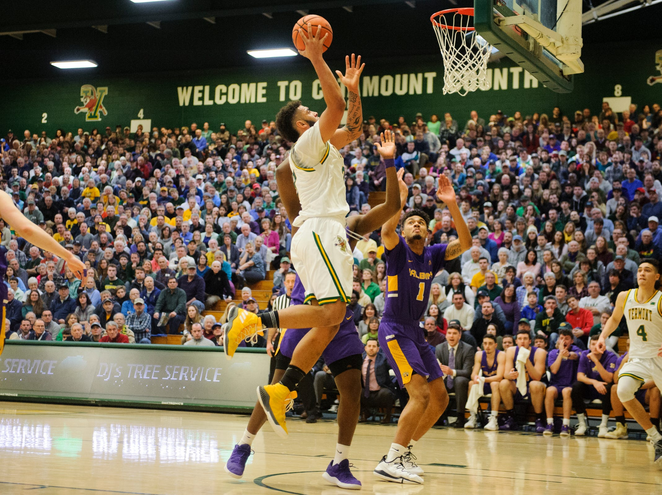 Vermont forward Anthony Lamb (3) leaps for a lay up during the men's basketball game between the Albany Great Danes and the Vermont Catamounts at Patrick Gym on Saturday February 9, 2019 in Burlington, Vermont.