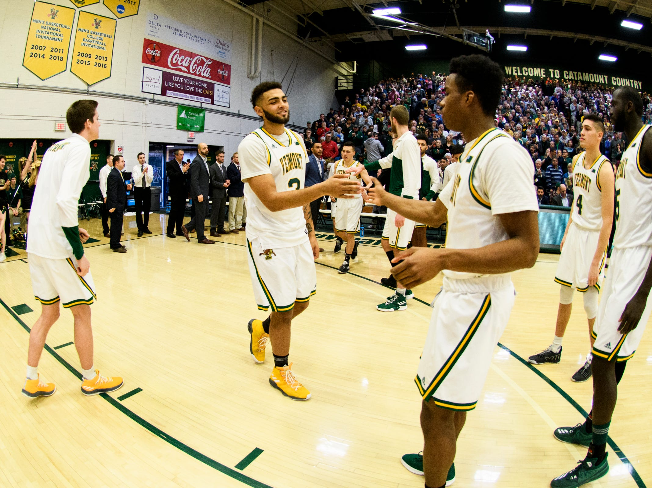 Vermont forward Anthony Lamb (3) is greeted by Vermont guard Stef Smith (0) as he takes the court during the men's basketball game between the Albany Great Danes and the Vermont Catamounts at Patrick Gym on Saturday February 9, 2019 in Burlington, Vermont.