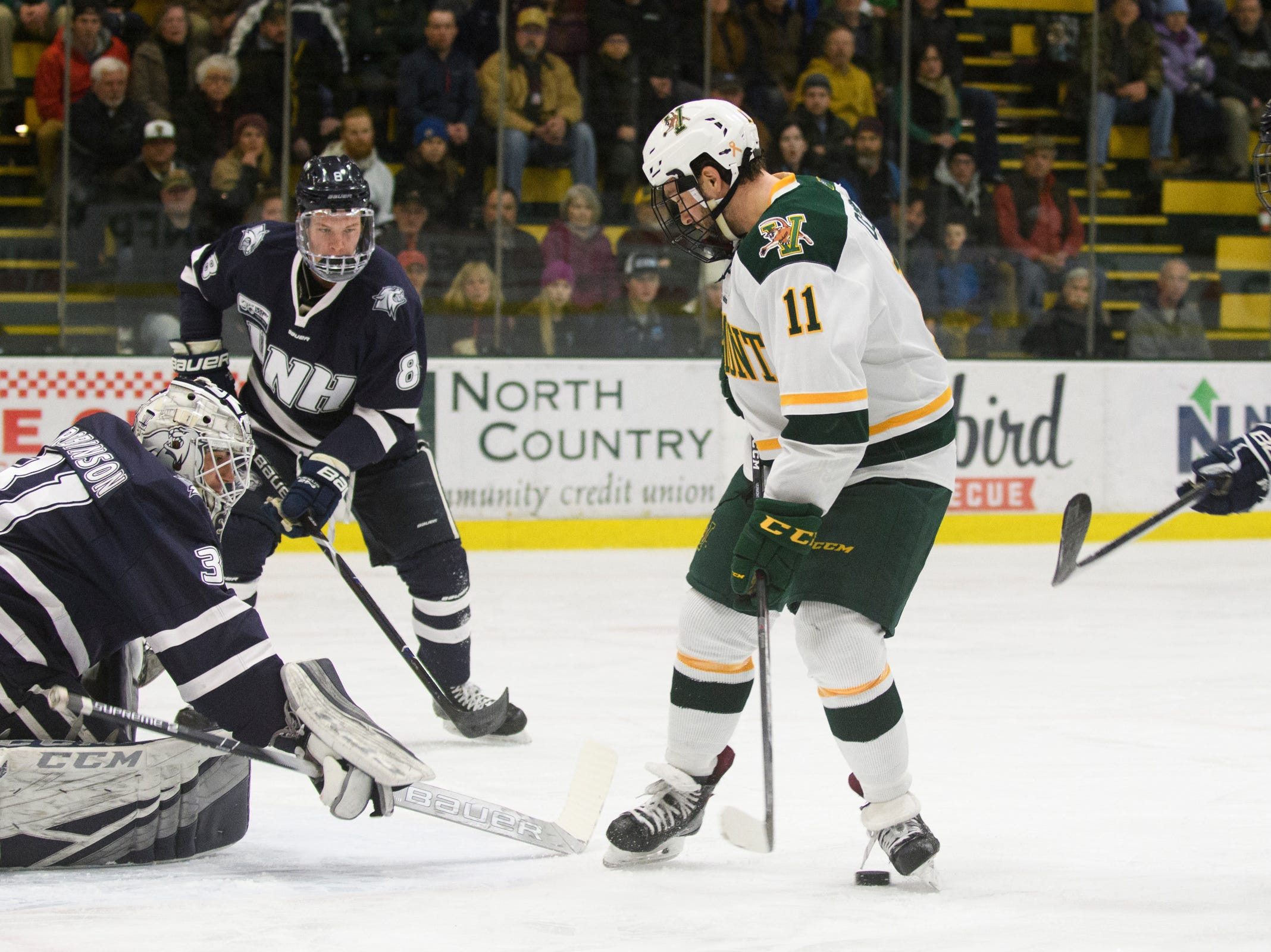 Vermont forward Conor O'Neil (11) looks for the puck  in front of the net during the men's hockey game between the New Hampshire Wildcats and the Vermont Catamounts at Gutterson Field House on Friday night February 8, 2019 in Burlington, Vermont.