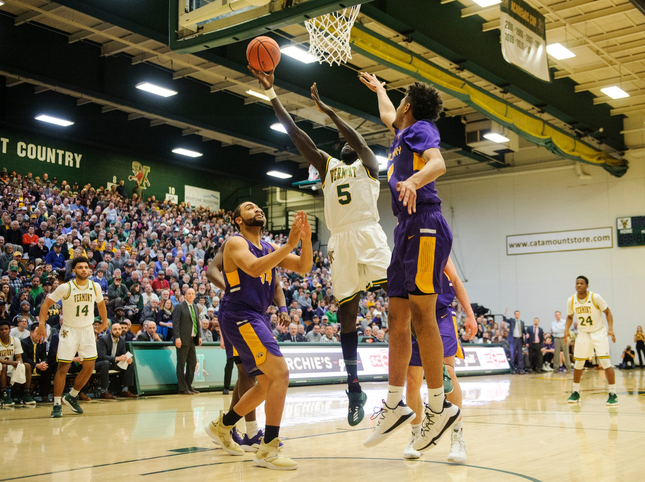 Vermont forward Samuel Dingba (5) leaps for a lay up during the men's basketball game between the Albany Great Danes and the Vermont Catamounts at Patrick Gym on Saturday February 9, 2019 in Burlington, Vermont.