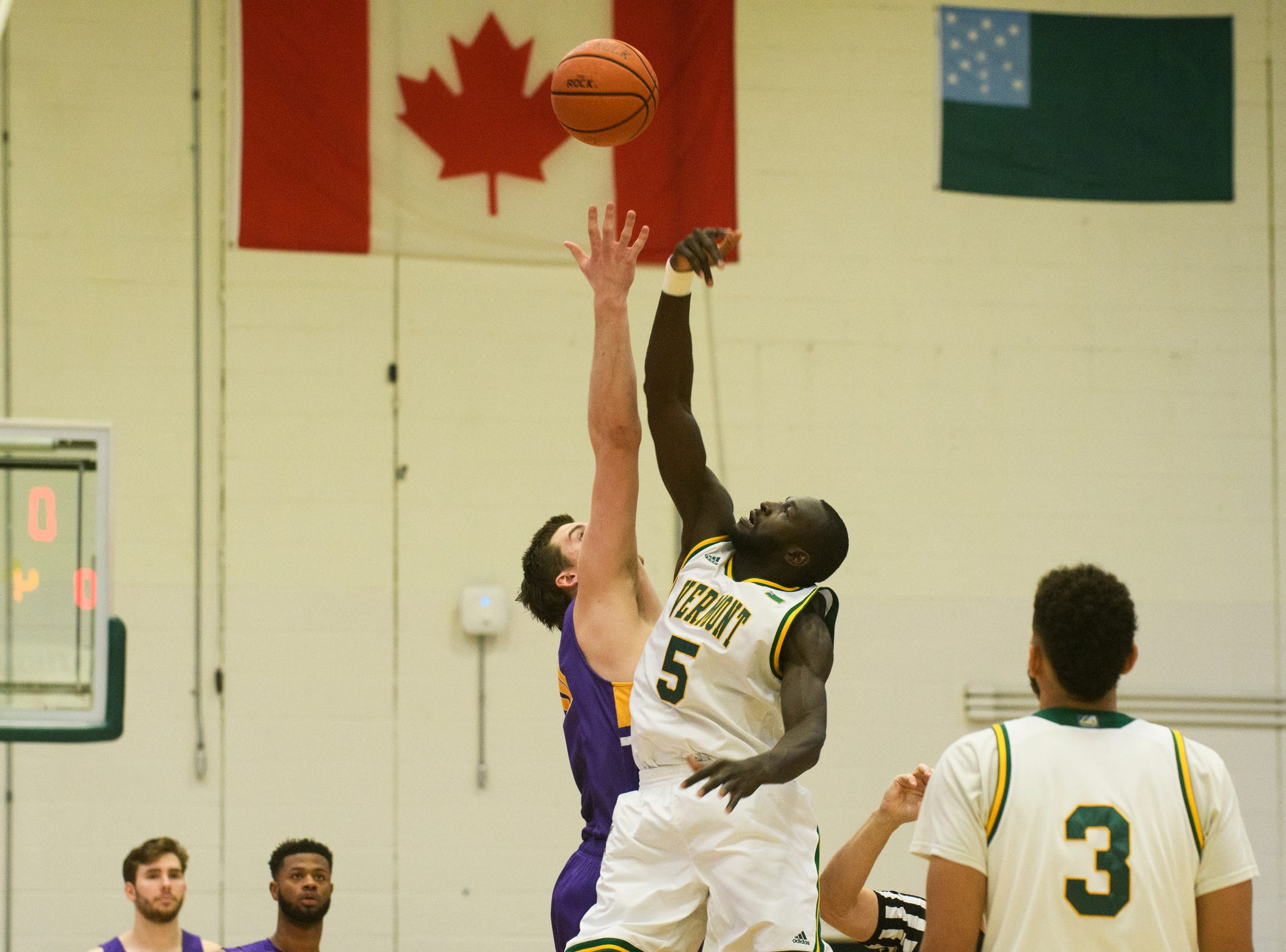 Vermont forward Samuel Dingba (5) battles for the opening tip off during the men's basketball game between the Albany Great Danes and the Vermont Catamounts at Patrick Gym on Saturday February 9, 2019 in Burlington, Vermont.