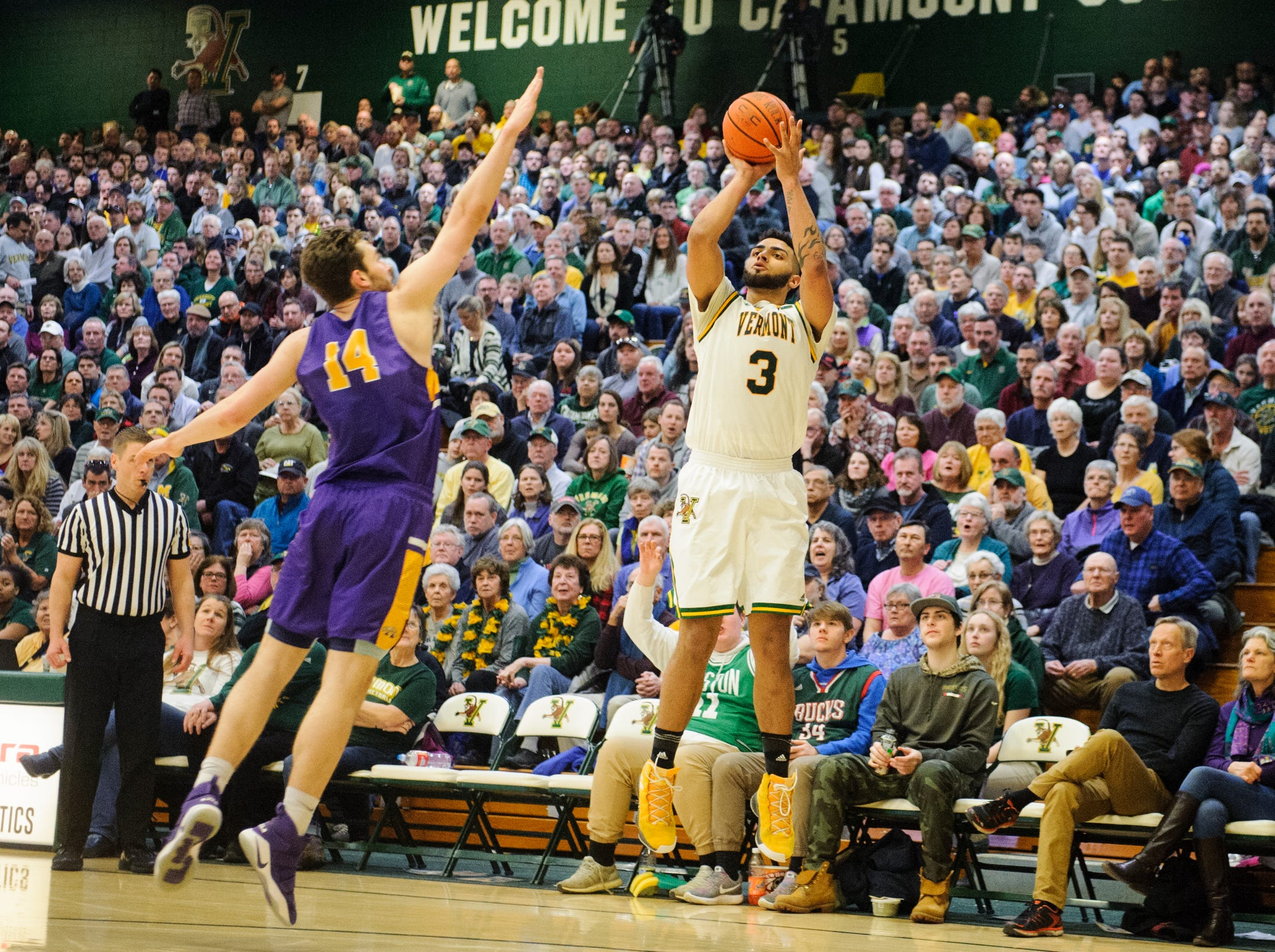 Vermont forward Anthony Lamb (3) shoots a three pointer over Albany's Adam Lulka (14) during the men's basketball game between the Albany Great Danes and the Vermont Catamounts at Patrick Gym on Saturday February 9, 2019 in Burlington, Vermont.
