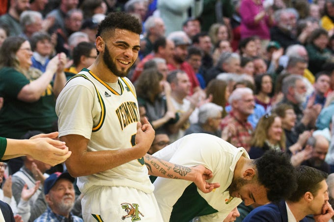 Vermont forward Anthony Lamb (3) celebrates a three pointer during the men's basketball game between the Albany Great Danes and the Vermont Catamounts at Patrick Gym on Saturday February 9, 2019 in Burlington, Vermont.
