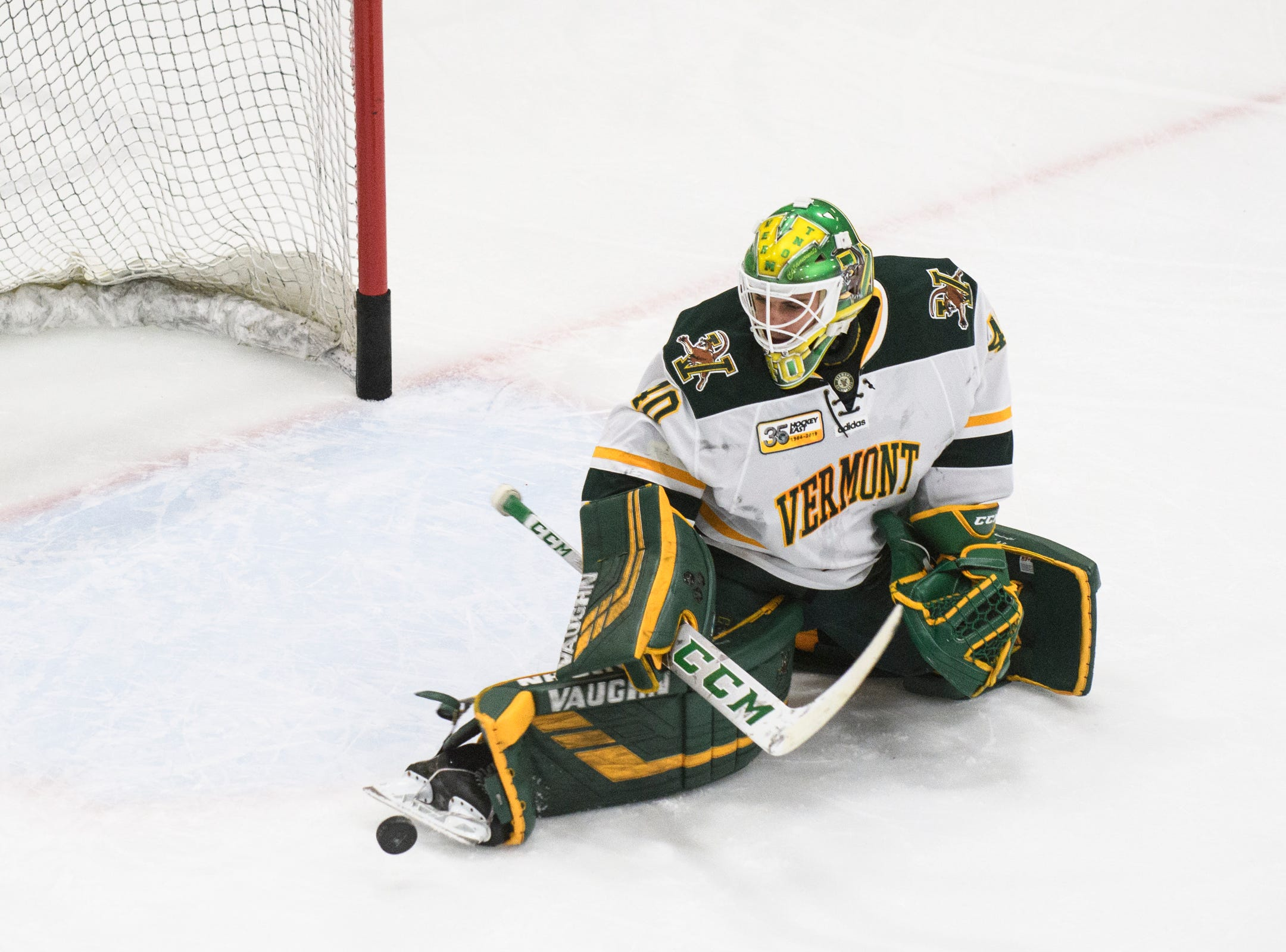 Vermont goalie Stefanos Lekkas (40) makes a save in warm ups during the men's hockey game between the New Hampshire Wildcats and the Vermont Catamounts at Gutterson Field House on Friday night February 8, 2019 in Burlington, Vermont.