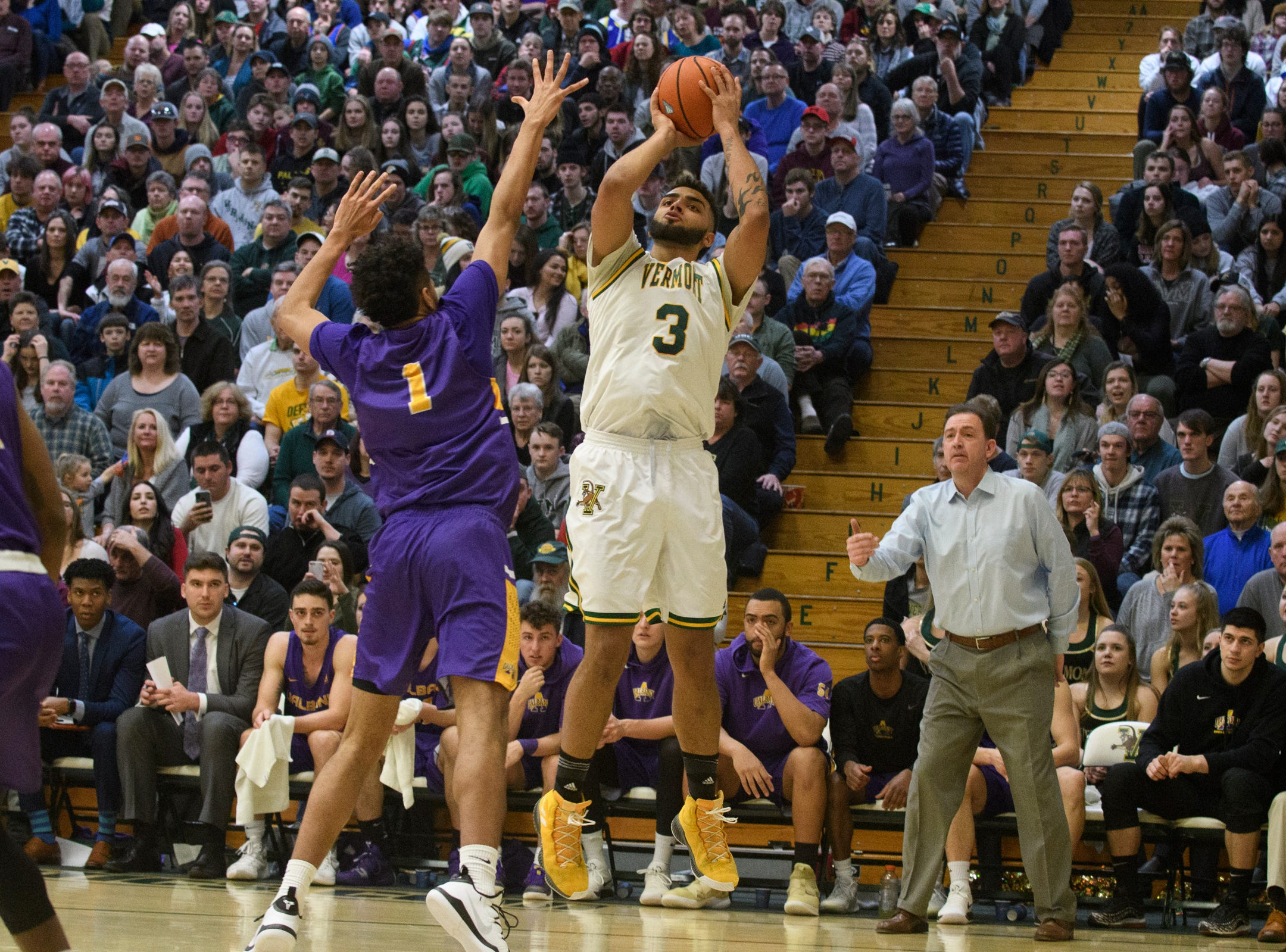 Vermont forward Anthony Lamb (3) shoots a three pointer over Albany's Malachi De Sousa (1) during the men's basketball game between the Albany Great Danes and the Vermont Catamounts at Patrick Gym on Saturday February 9, 2019 in Burlington, Vermont.