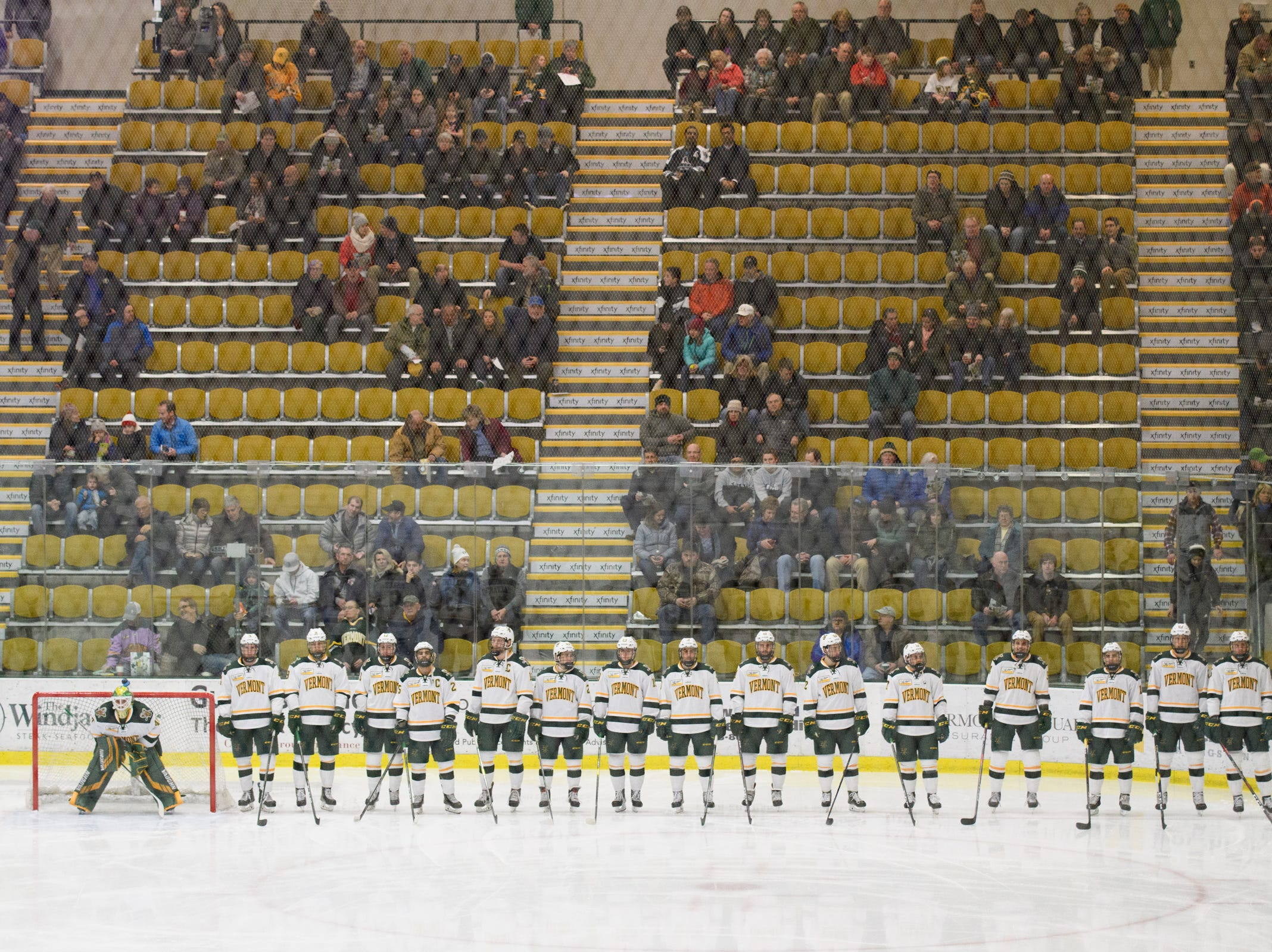 Vermont stands at the blue line for player introductions during the men's hockey game between the New Hampshire Wildcats and the Vermont Catamounts at Gutterson Field House on Friday night February 8, 2019 in Burlington, Vermont.