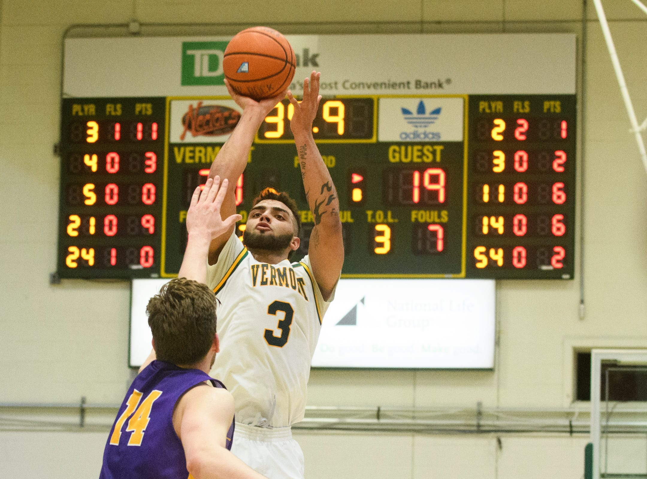 Vermont forward Anthony Lamb (3) shoots the ball over Albany's Adam Lulka (14) during the men's basketball game between the Albany Great Danes and the Vermont Catamounts at Patrick Gym on Saturday February 9, 2019 in Burlington, Vermont.