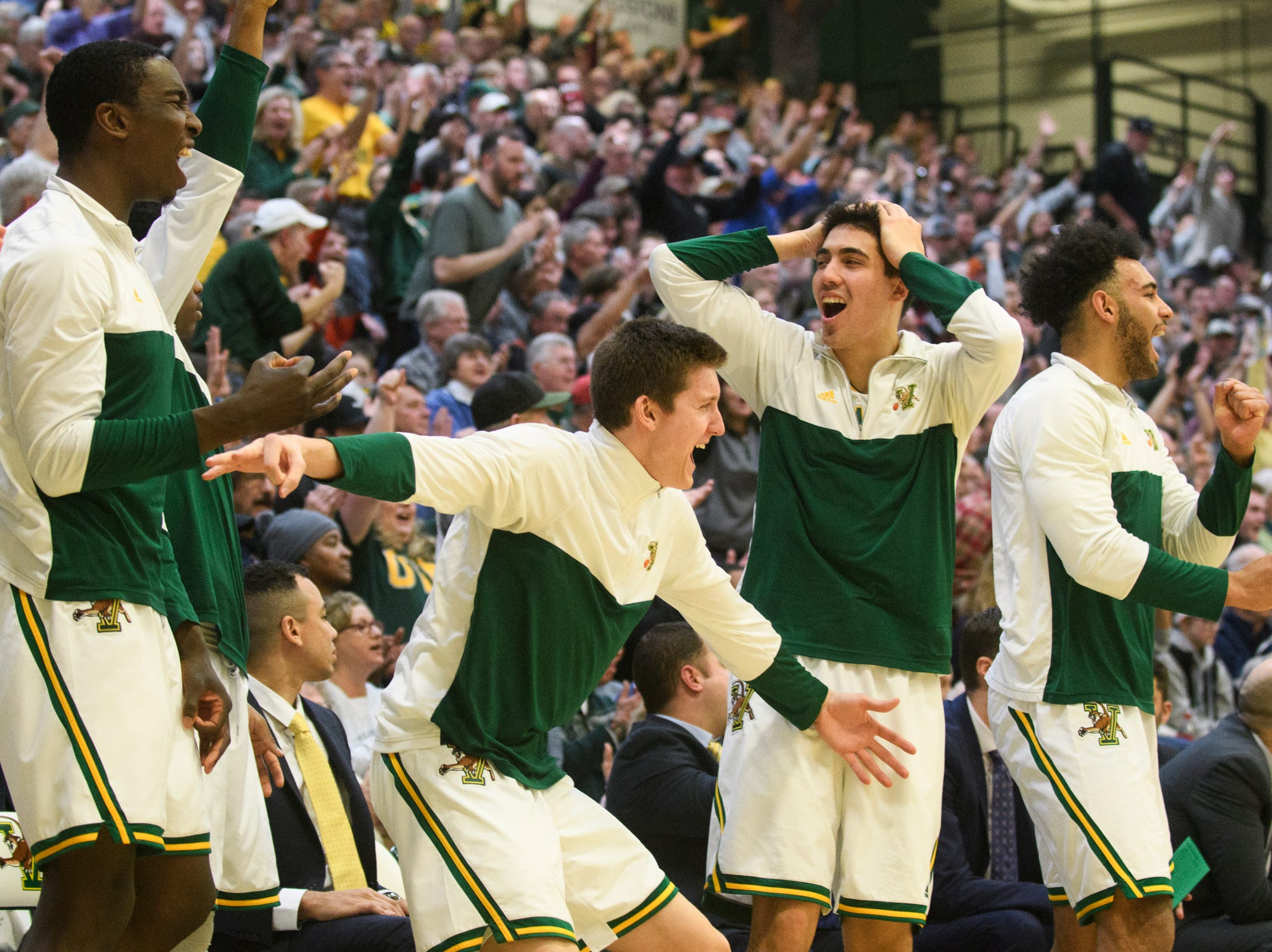 The Vermont bench reacts to a three pointer by Vermont guard Ernie Duncan (20) (Not pictured) during the men's basketball game between the Albany Great Danes and the Vermont Catamounts at Patrick Gym on Saturday February 9, 2019 in Burlington, Vermont.