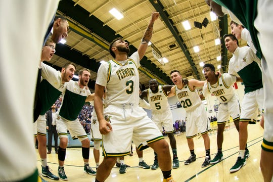 Vermont forward Anthony Lamb (3) pumps up the team in the huddle during the men's basketball game between the Albany Great Danes and the Vermont Catamounts at Patrick Gym on Saturday February 9, 2019 in Burlington, Vermont.