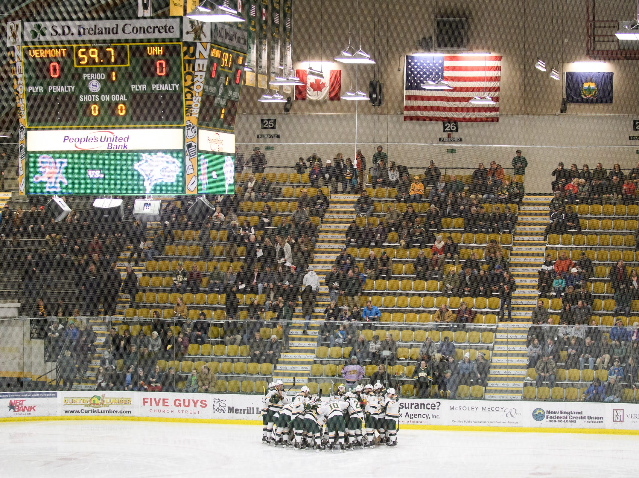 Vermont huddles together during the men's hockey game between the New Hampshire Wildcats and the Vermont Catamounts at Gutterson Field House on Friday night February 8, 2019 in Burlington, Vermont.