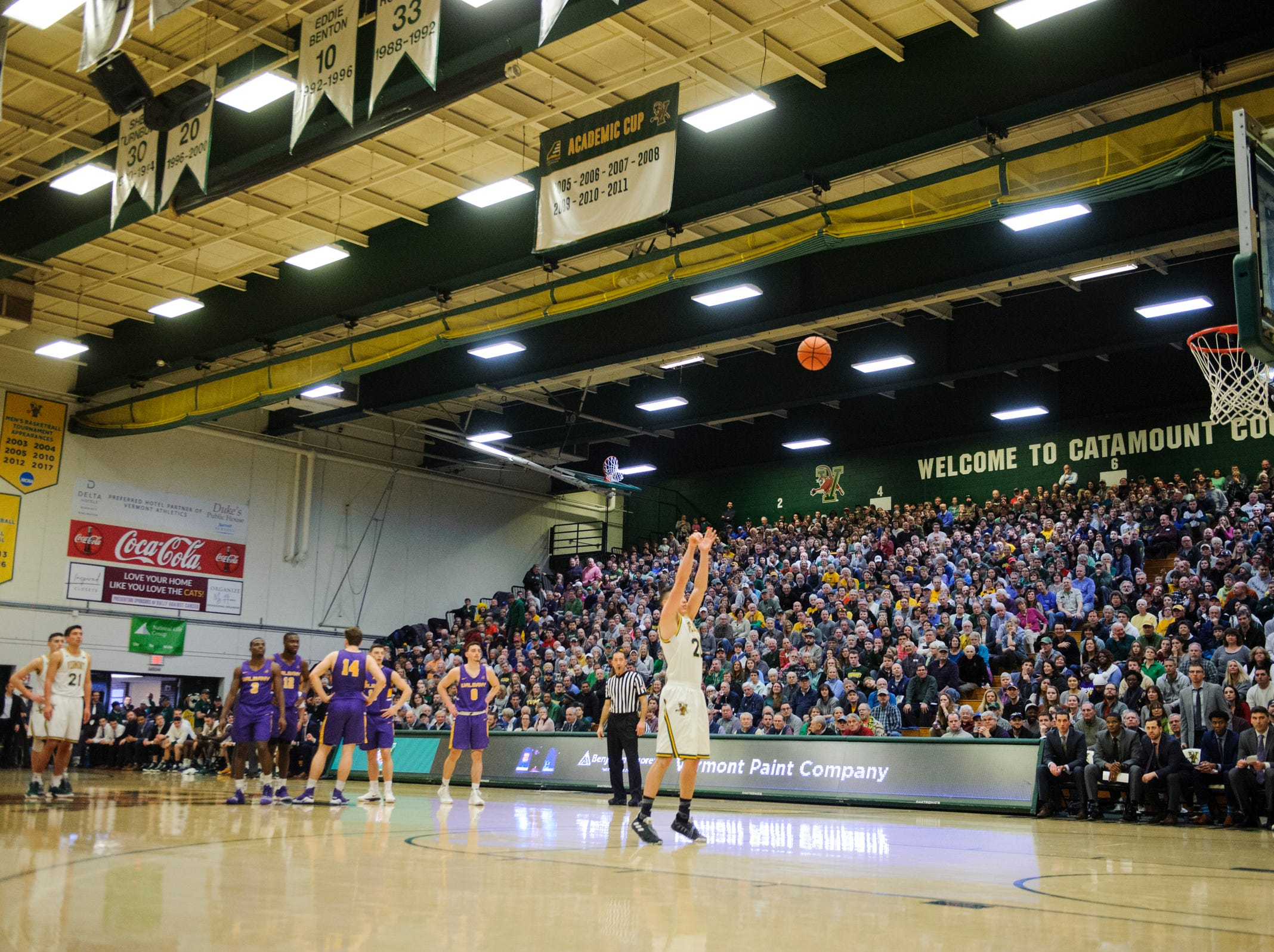 Vermont guard Ernie Duncan (20) shoots a free throw after a technical foul call on Albany head coach Will Brown during the men's basketball game between the Albany Great Danes and the Vermont Catamounts at Patrick Gym on Saturday February 9, 2019 in Burlington, Vermont.