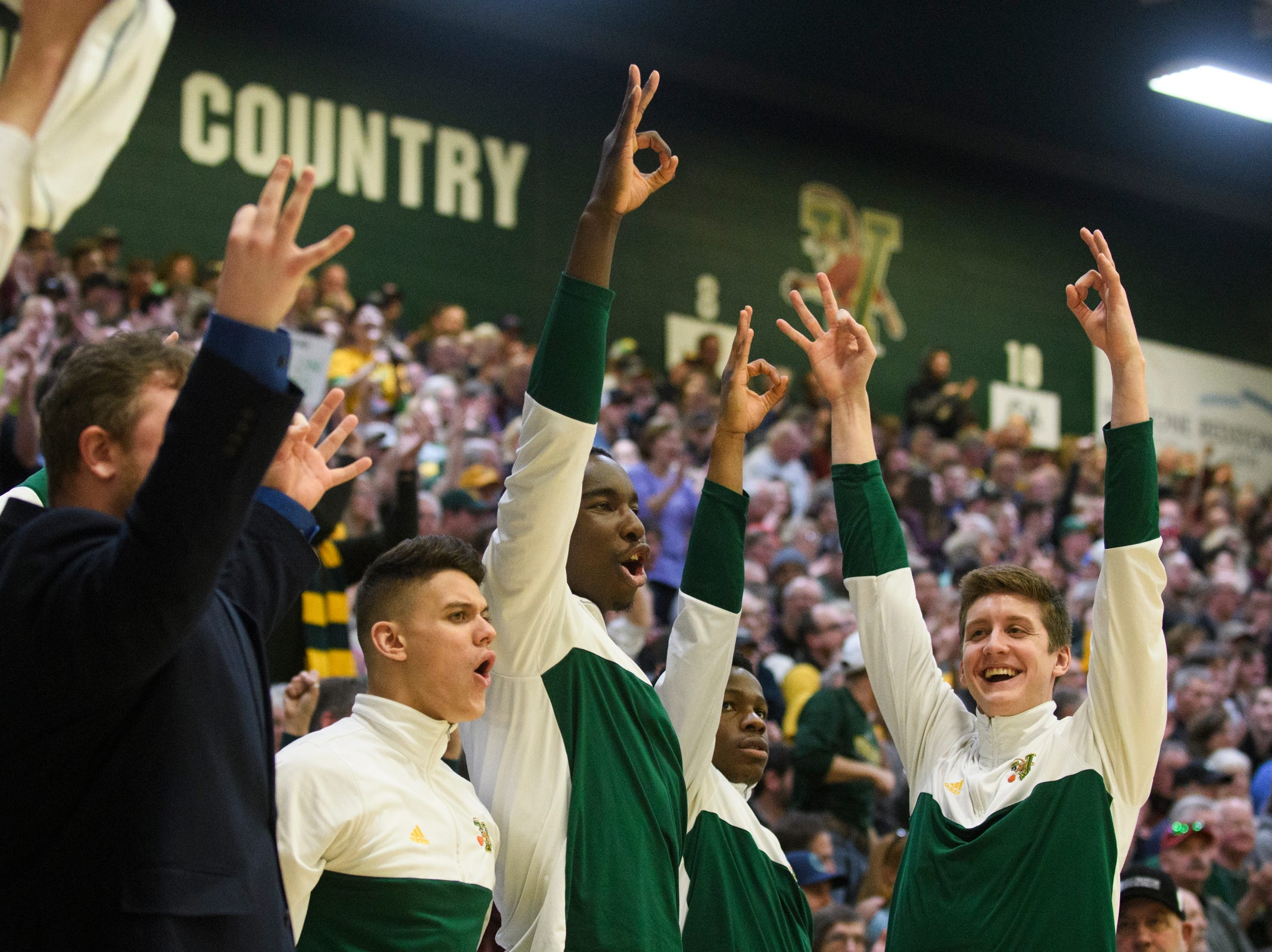 The Vermont bench reacts to a three pointer during the men's basketball game between the Albany Great Danes and the Vermont Catamounts at Patrick Gym on Saturday February 9, 2019 in Burlington, Vermont.