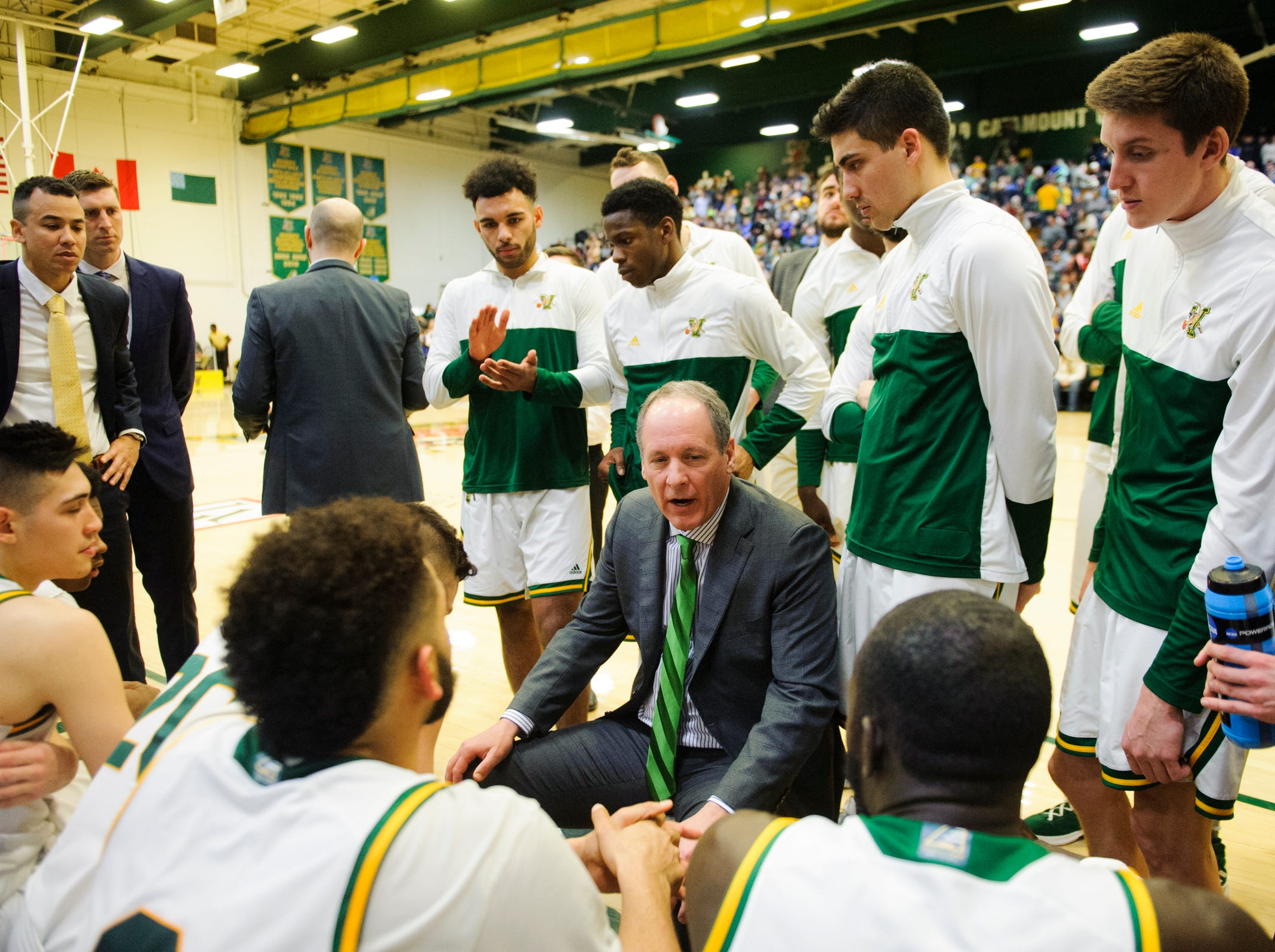 Vermont head coach John Becker talks to the team during a time out in the men's basketball game between the Albany Great Danes and the Vermont Catamounts at Patrick Gym on Saturday February 9, 2019 in Burlington, Vermont.