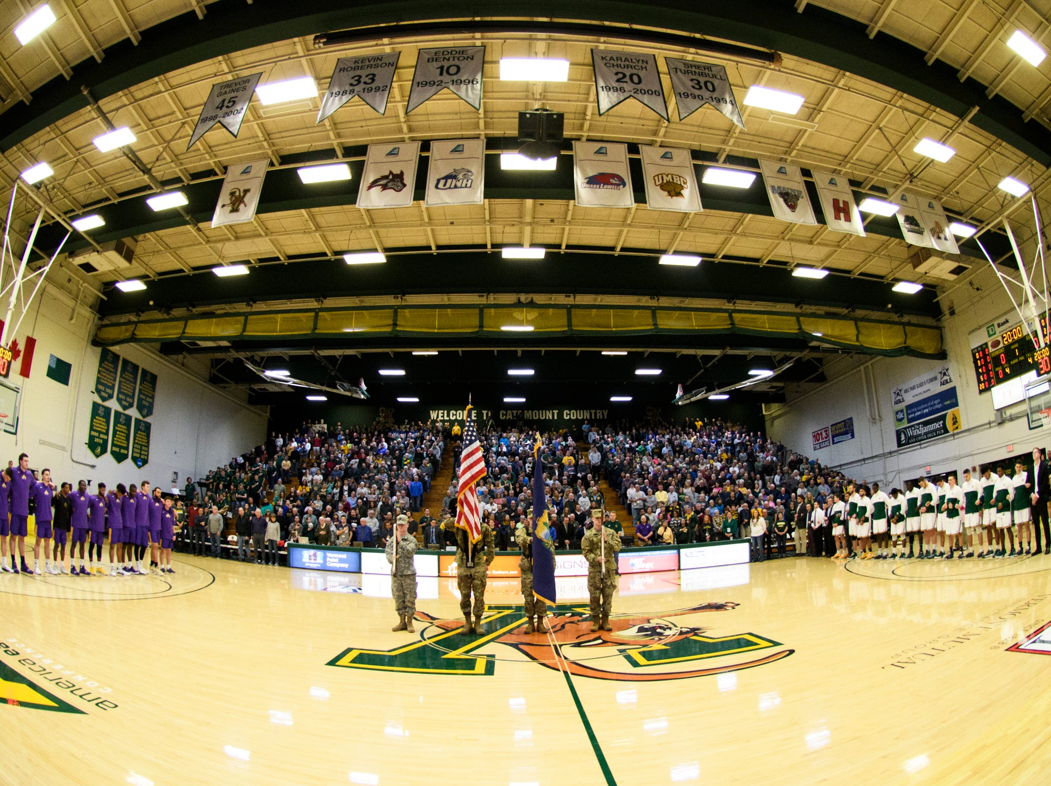 The color guard takes the court during the playing of the National Anthem in the men's basketball game between the Albany Great Danes and the Vermont Catamounts at Patrick Gym on Saturday February 9, 2019 in Burlington, Vermont.