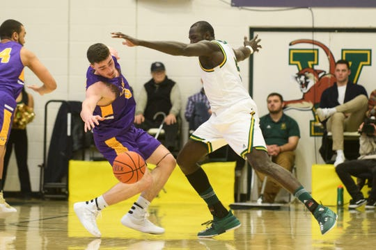 Vermont forward Samuel Dingba (5) battles for the loose ball with Albany's Antonio Rizzuto (0) during the men's basketball game between the Albany Great Danes and the Vermont Catamounts at Patrick Gym on Saturday February 9, 2019 in Burlington, Vermont.