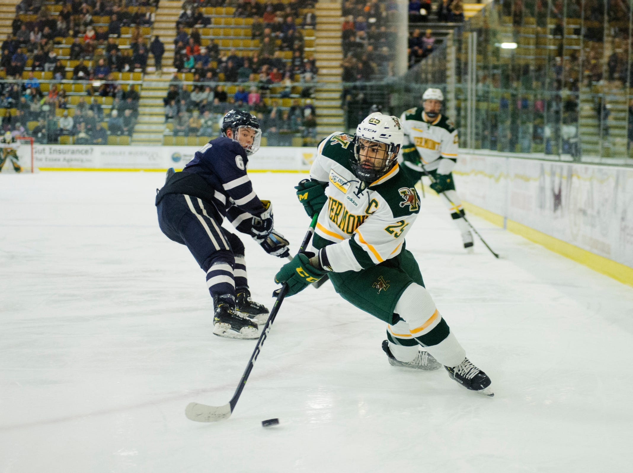 Vermont forward Matt Alvaro (25) skates with the puck during the men's hockey game between the New Hampshire Wildcats and the Vermont Catamounts at Gutterson Field House on Friday night February 8, 2019 in Burlington, Vermont.