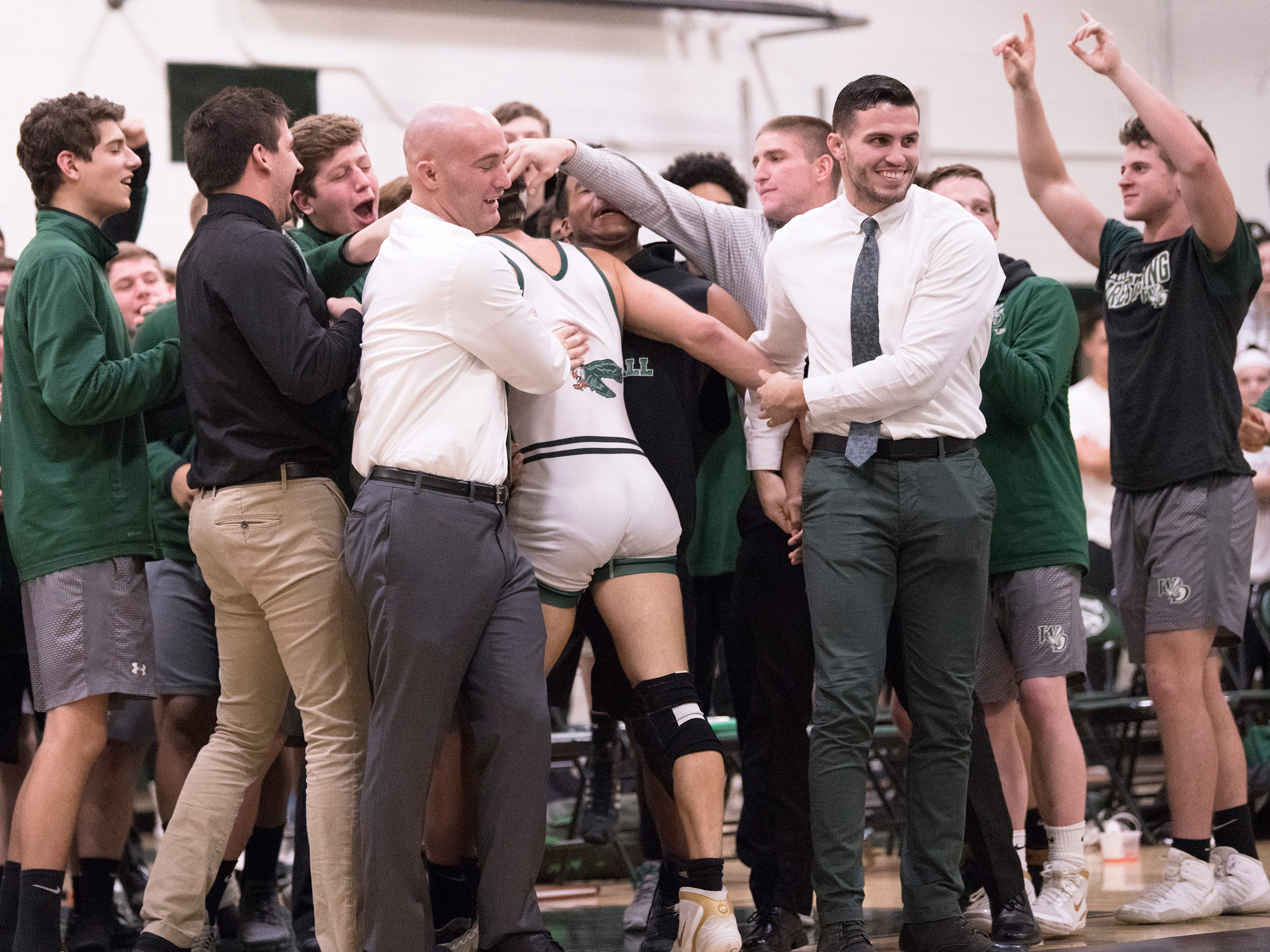 Members of the West Deptford High School wrestling team celebrate after West Deptford's Corey Fischer pinned Haddonfield's Aidan Barr during the 160 lb. bout of the the SJ Group 2 title meet held at West Deptford High School on Friday, February 8, 2019.     West Deptford defeated Haddonfield, 38-20.