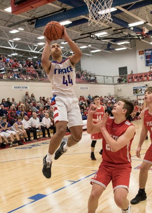 Zane Trace basketball's Triton Davidson goes up for a layup in a 55-43 win over Piketon. ZT will make the switch from D-II to D-III next season.