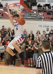 Zane Trace's Nick Nesser makes a crowd-pleasing dunk during the last moments of a game against Piketon Feb. 8 at Zane Trace High School. Zane Trace defeated Piketon 55-43 to guarantee a share of the SVC title.