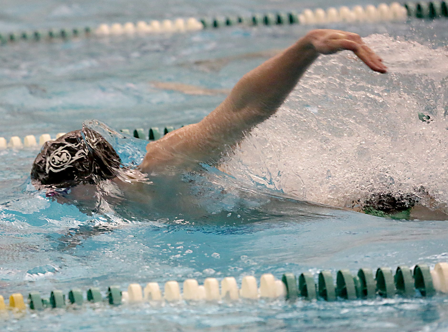 Adam Chaney, from Mason, competes in the 50-yard freestyle during the Division I and Division II sectionals at Mason High School in Mason Friday, Feb. 8, 2019.