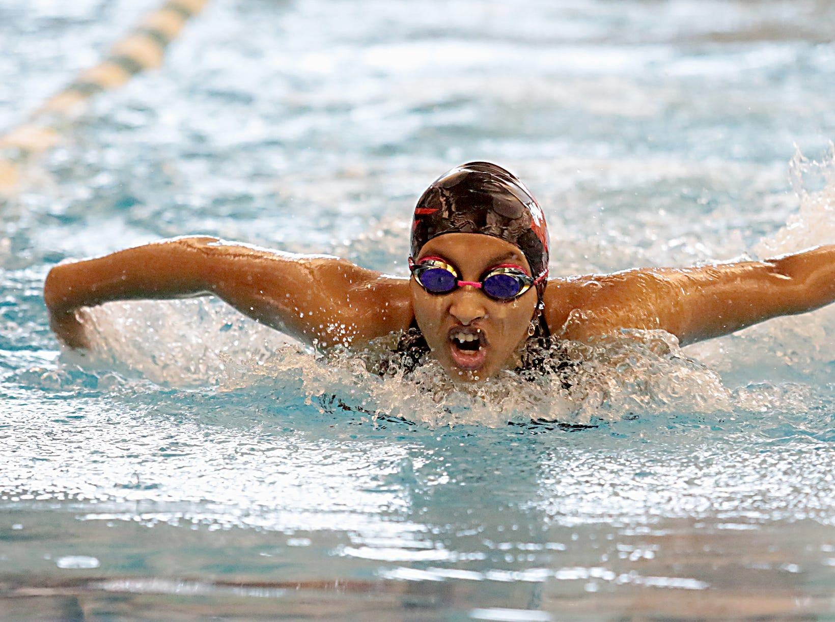 Shreya Terala, from Milford, competes in the 200-yard IM during the Division I and II sectionals at Mason High School Saturday, Feb. 9, 2019.