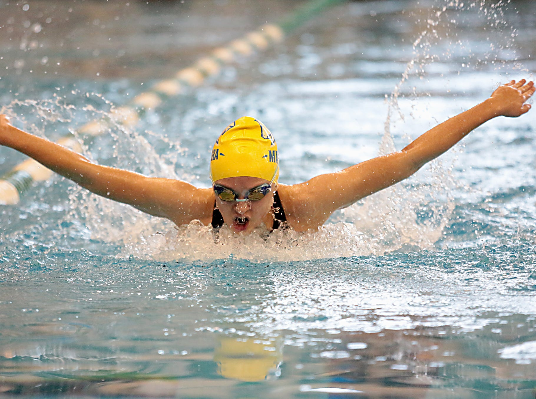 Ava Cunningham, from Madeira, competes in the 200-yard IM during the Division I and II sectionals at Mason High School Saturday, Feb. 9, 2019.
