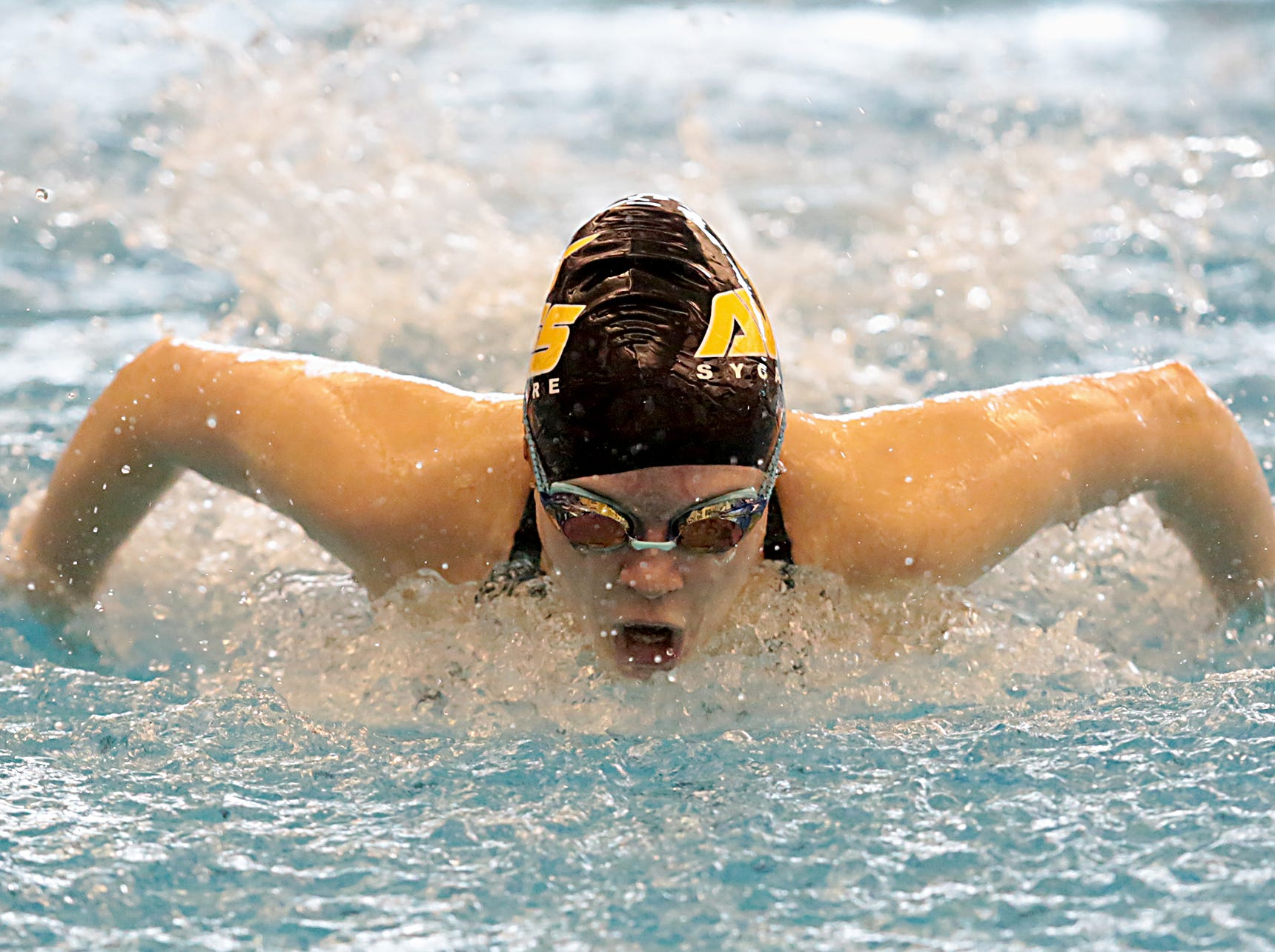 Olivia Shields, from Sycamore, competes in the 100-yard butterfly during the Division I and II sectionals at Mason High School Saturday, Feb. 9, 2019.