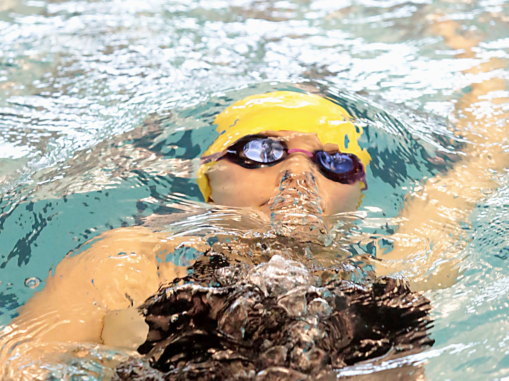 Grace Rindels, from Madeira, competes in the 200-yard IM during the Division I and II sectionals at Mason High School Saturday, Feb. 9, 2019.