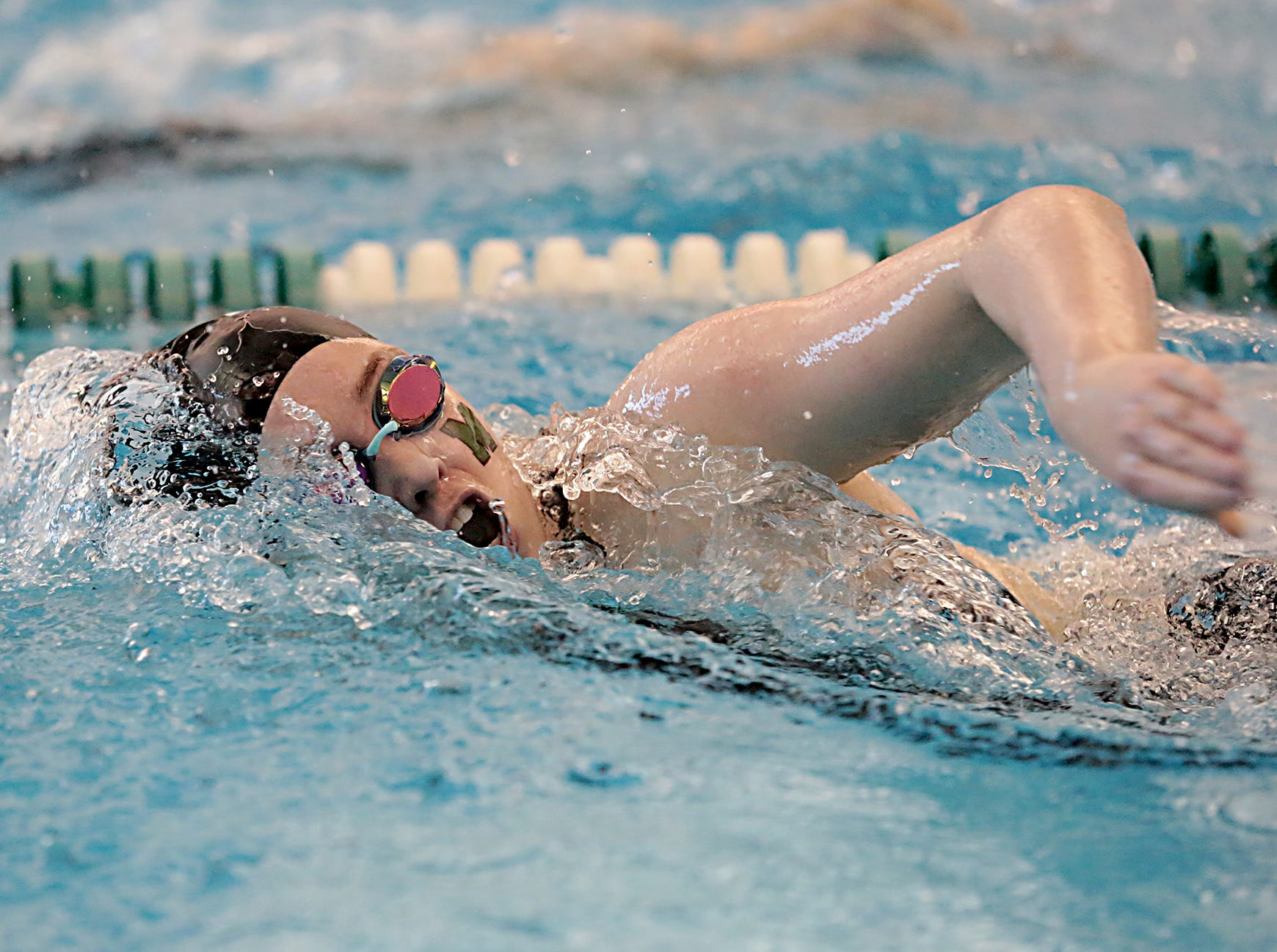 Allison Fries, from Mason, competes in the 200-yard freestyle during the Division I and II sectionals at Mason High School Saturday, Feb. 9, 2019.