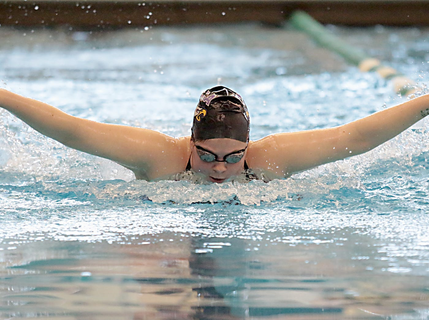 Gigi Paris, from Cincinnati Hills Christian Academy, competes in the 100-yard butterfly during the Division I and II girls sectionals at Mason High School Saturday, Feb. 9, 2019.