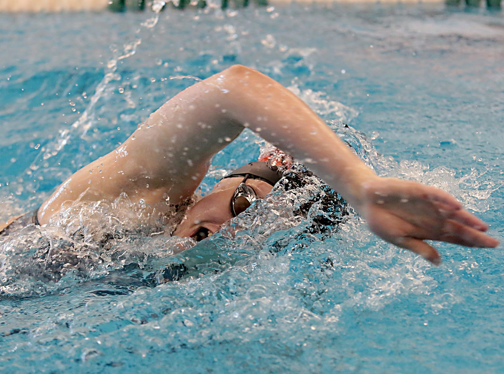 Lauren Clark, from Milford, competes in the 200-yard freestyle during the Division I and II sectionals at Mason High School Saturday, Feb. 9, 2019.