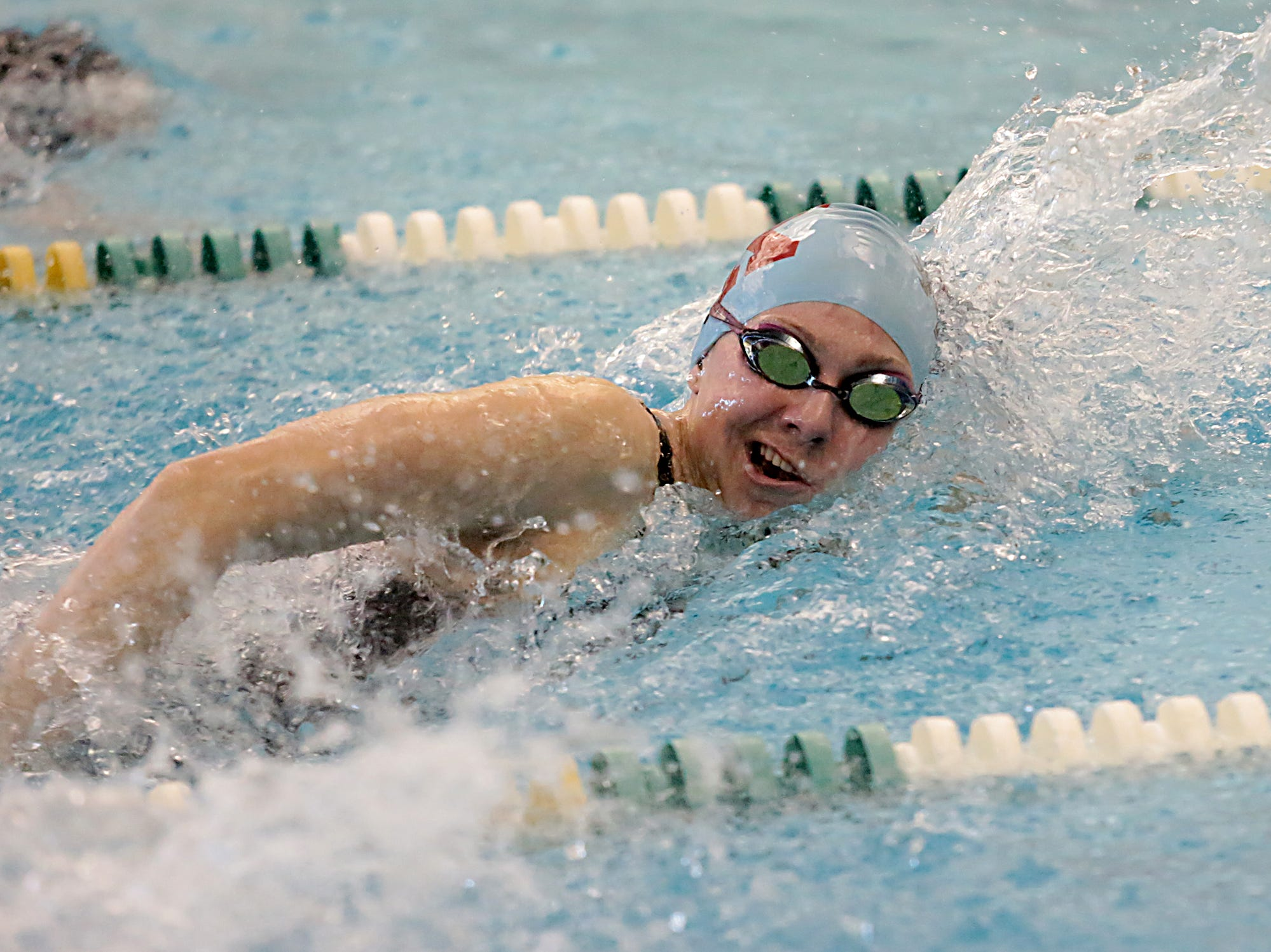 Leah Luckett, from Kings, competes in the 200-yard freestyle during the Division I and II sectionals at Mason High School Saturday, Feb. 9, 2019.