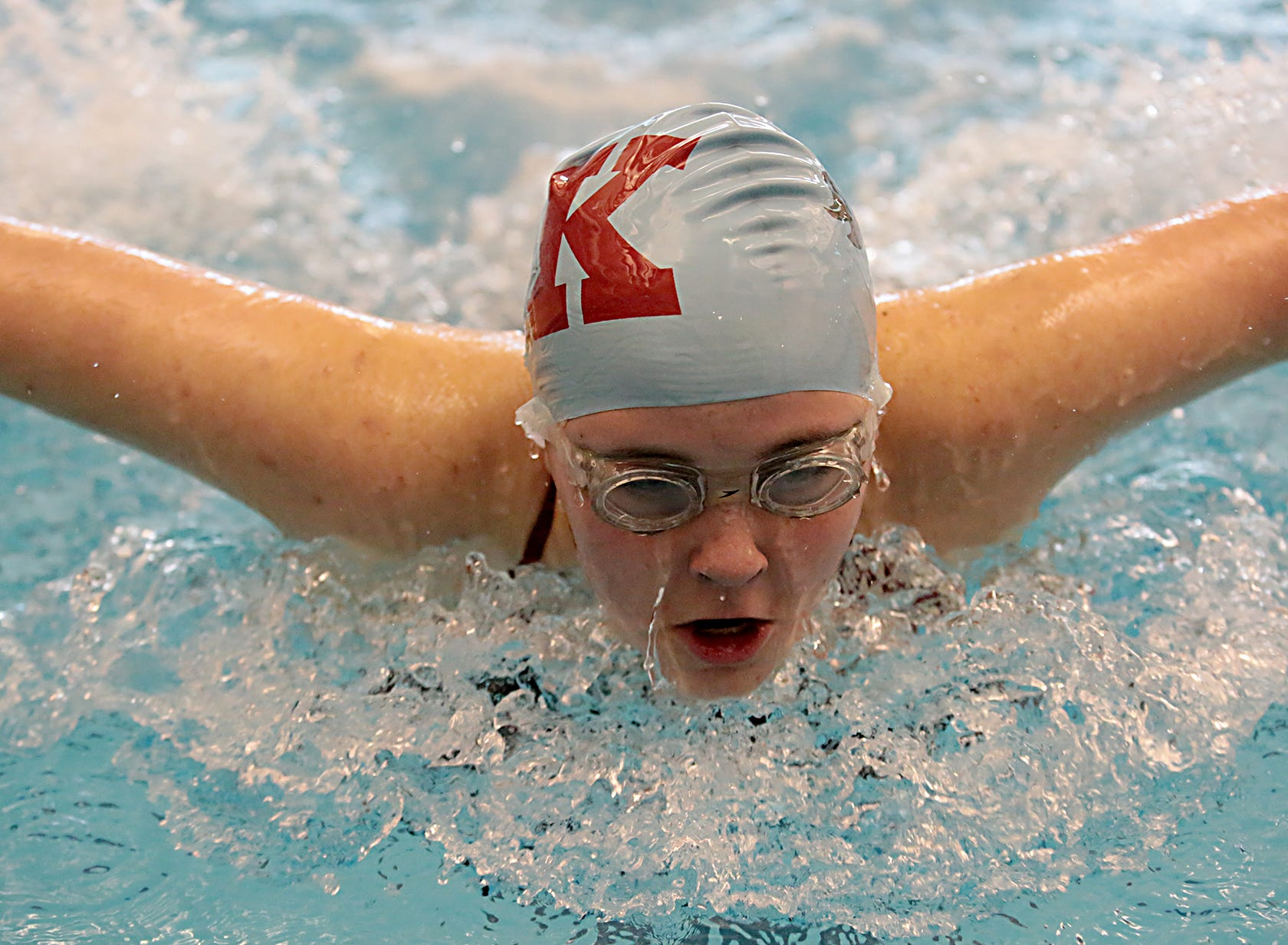 Aubrey Schimpf, from Kings, competes in the 100-yard butterfly during the Division I and II sectionals at Mason High School Saturday, Feb. 9, 2019.