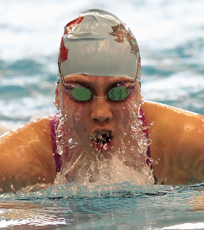 Jordan Harkins, from Kings, competes in the 200-yard IM during the Division I and II girls sectionals at Mason High School Saturday, Feb. 9, 2019.