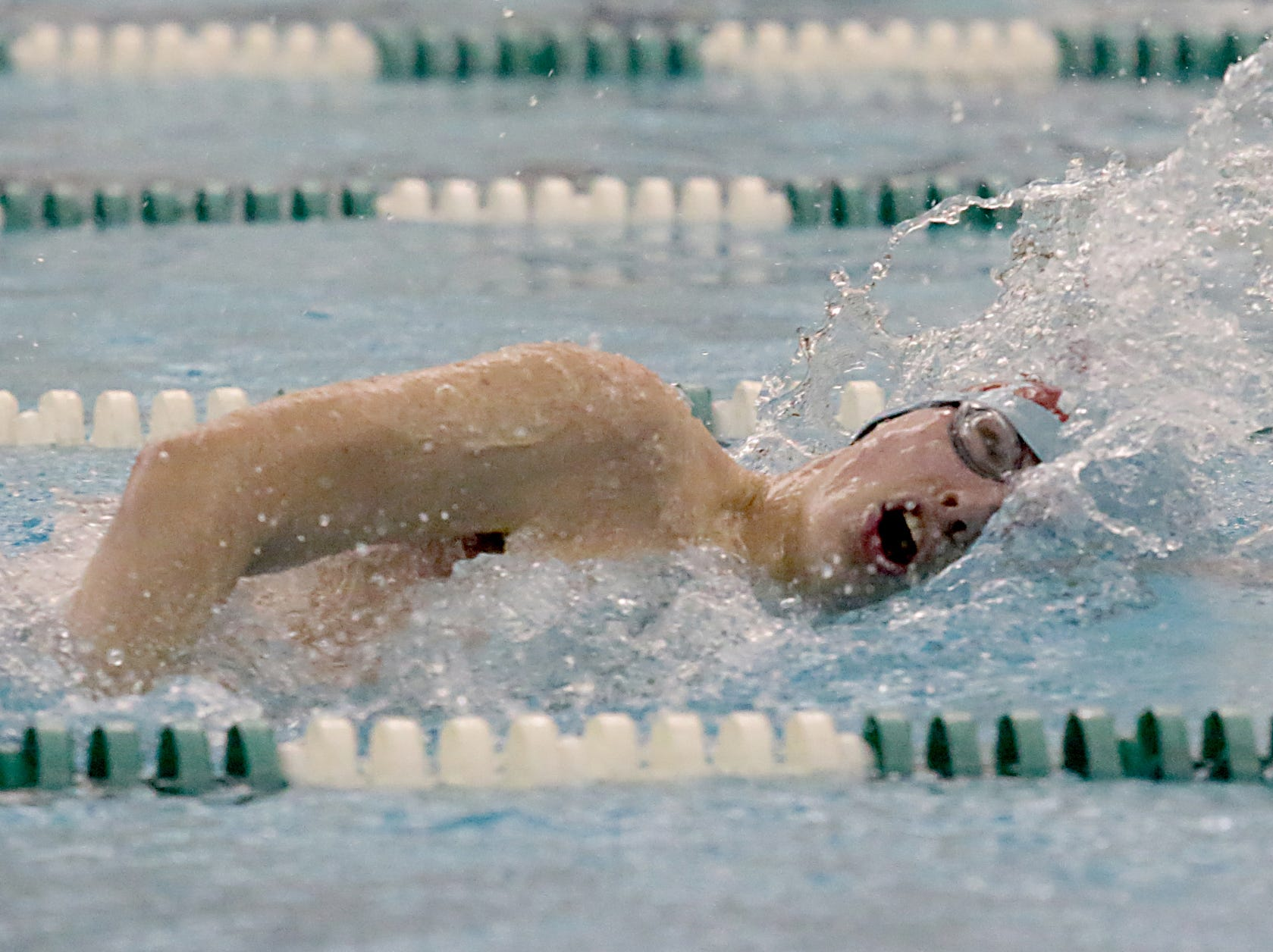 Zach Cunningham, from Kings, competes in the 200-yard freestyle during the Division I and Division II sectionals at Mason High School in Mason Friday, Feb. 8, 2019.