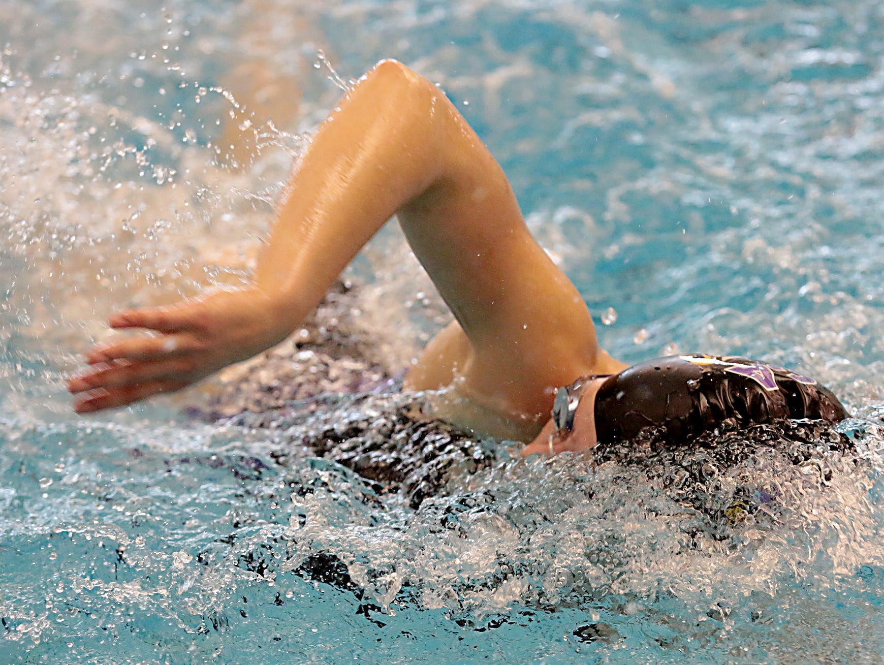 Maggie Pairan, from Cincinnati Hills Christian Academy, competes in the 50-yard freestyle during the Division I and II girls sectionals at Mason High School Saturday, Feb. 9, 2019.
