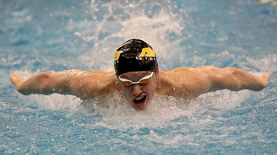 Jake Foster, from Sycamore, competes in the 200-yard IM during the Division I and Division II sectionals at Mason High School in Mason Friday, Feb. 8, 2019.